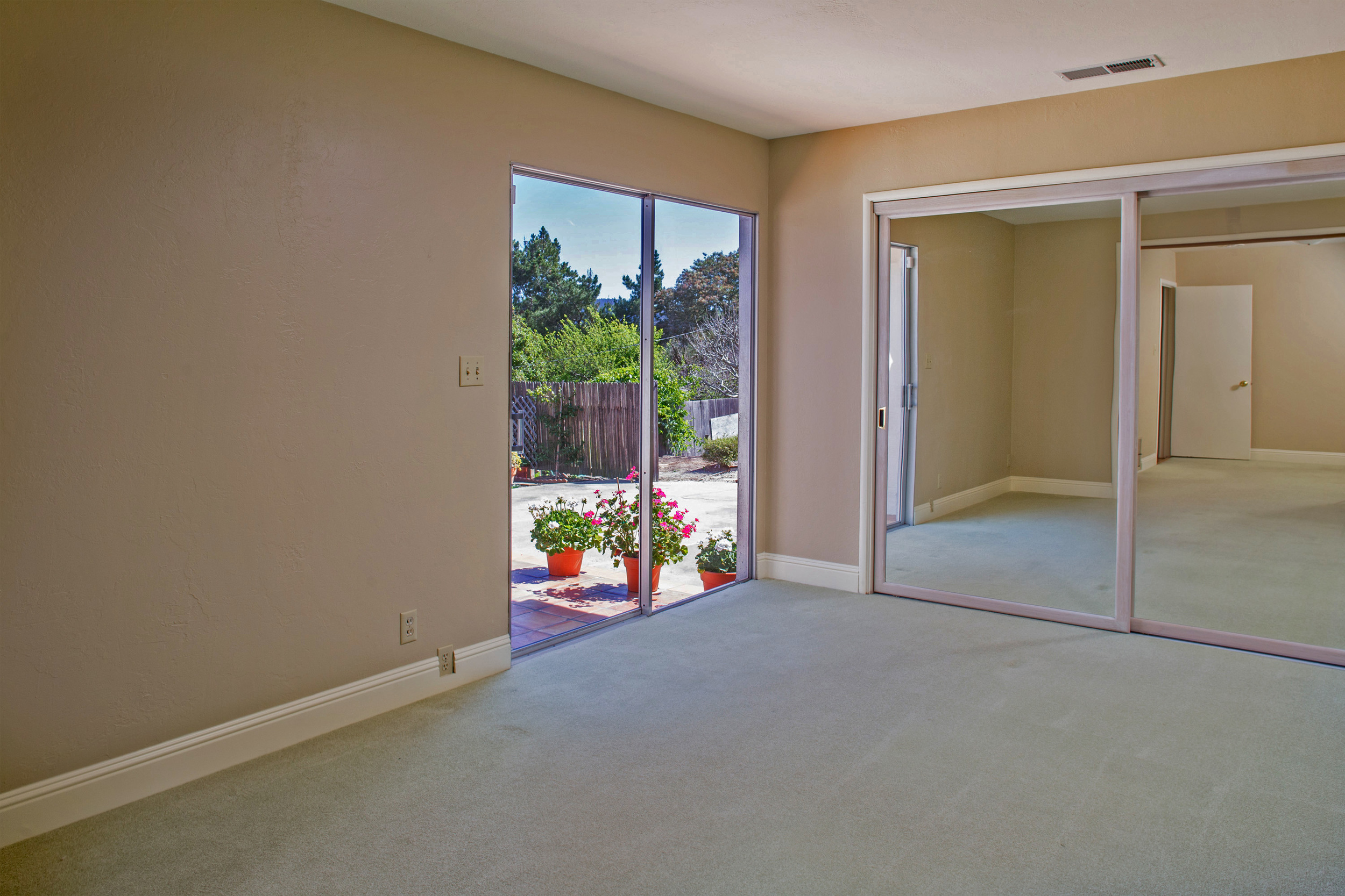 11-bedroom with sliding glass doors that exits to a beautiful tile patio.jpg