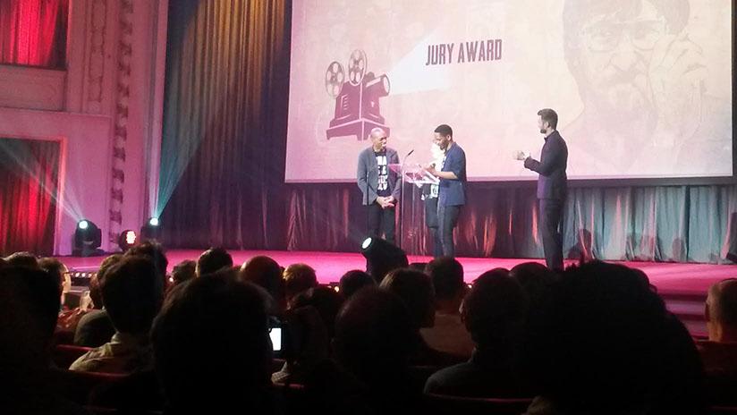 Jim Chuchu receives the Teddy Jury Award on behalf of the NEST Collective.