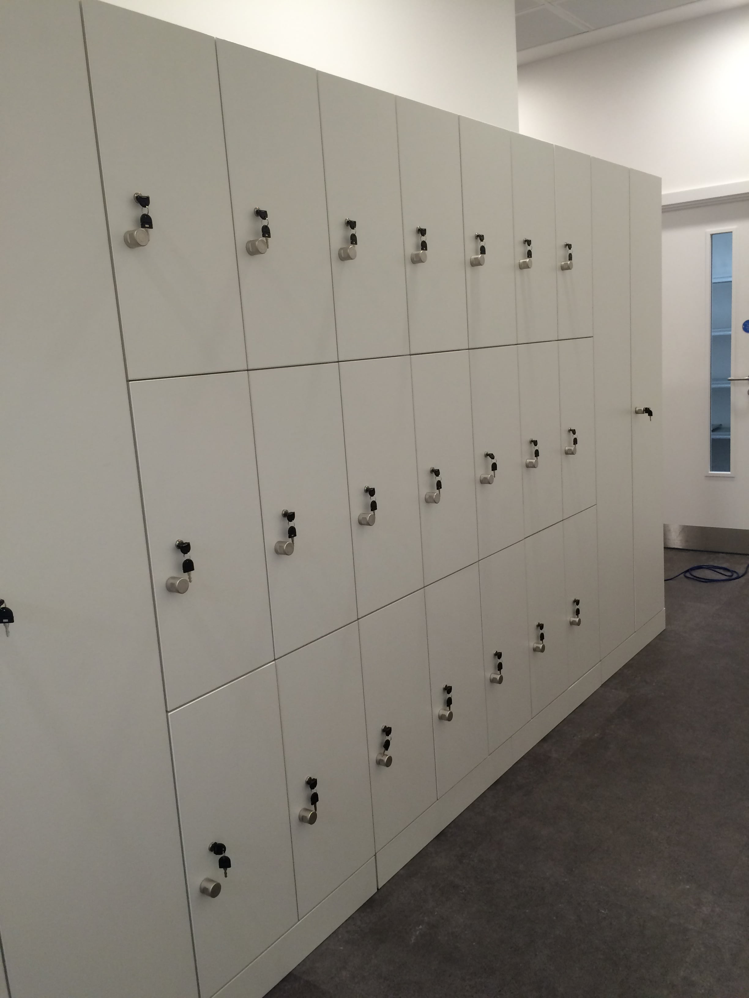 The private staff space needed to be secure and provide adequate storage for all staff during their working day. We provided lockable lockers to hold their bags and small- to medium-sized items, while also ensuring that their coats and jackets did not become creased by supplying full-length cupboards with hanging facilities.