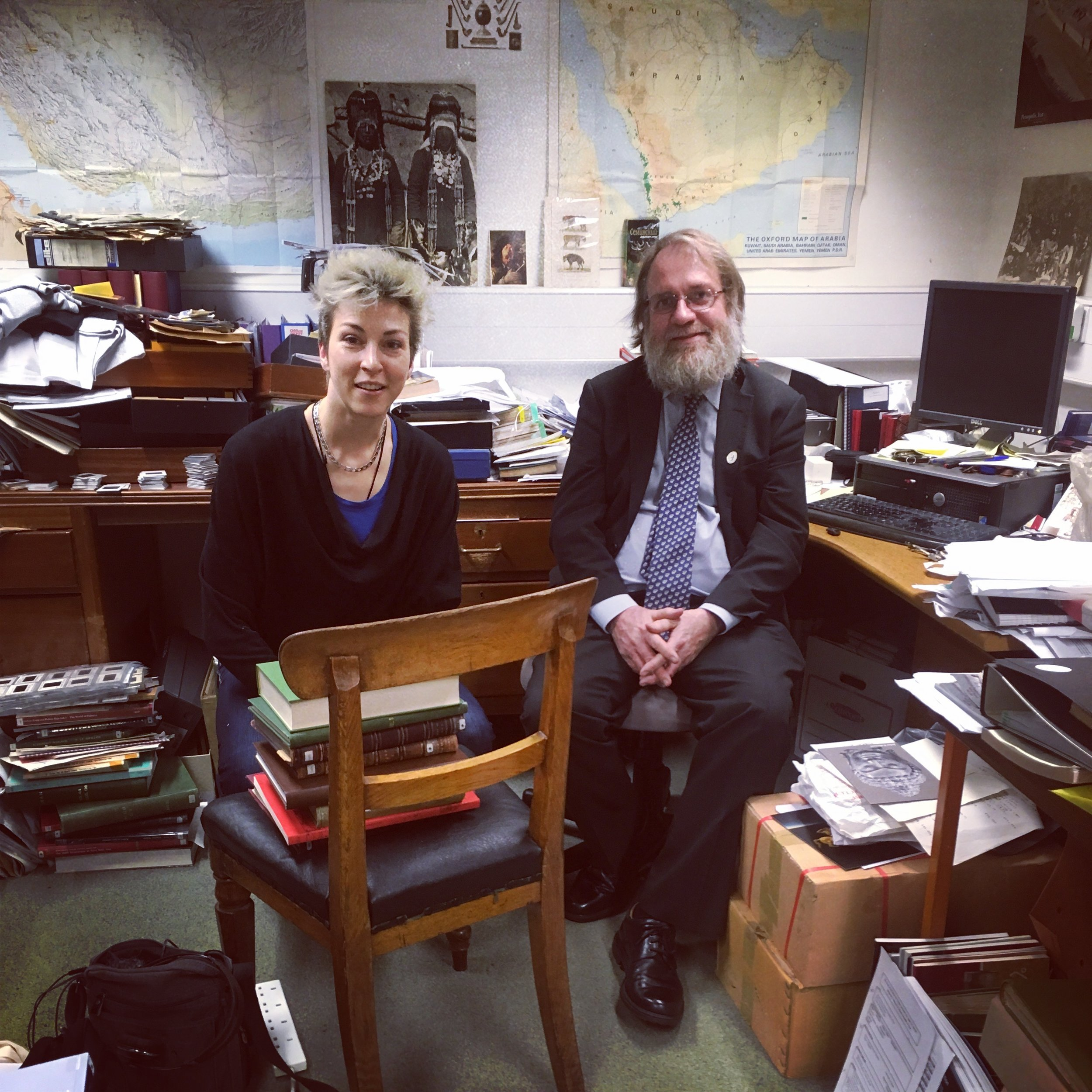 Iszi and St John Simpson in his cluttered office just after recording.