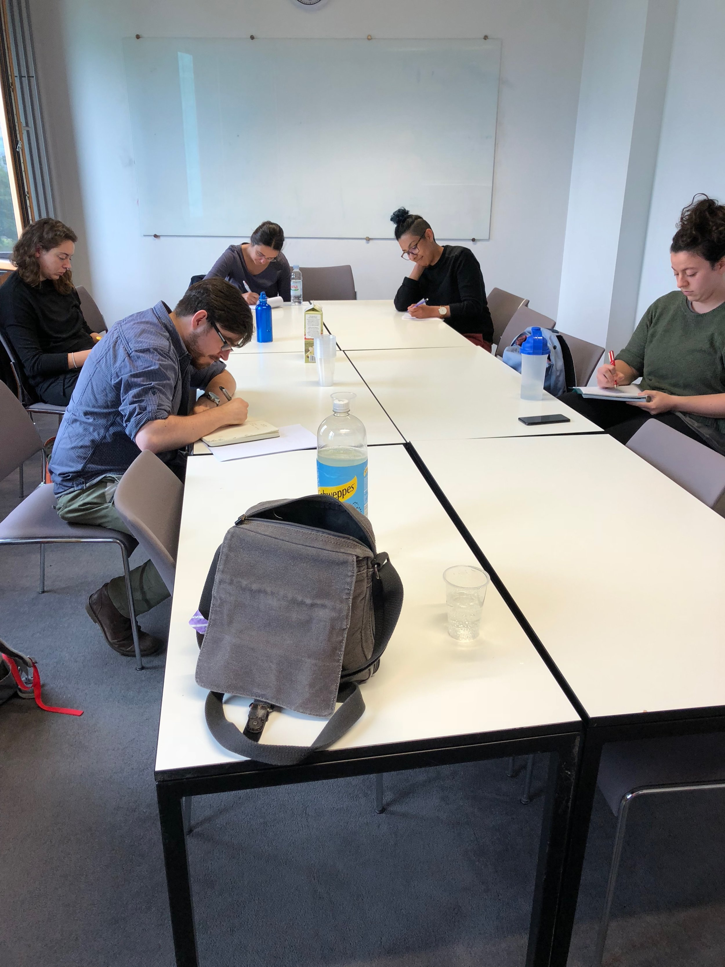 A small group doing a speech writing exercise at Sheffiled University
