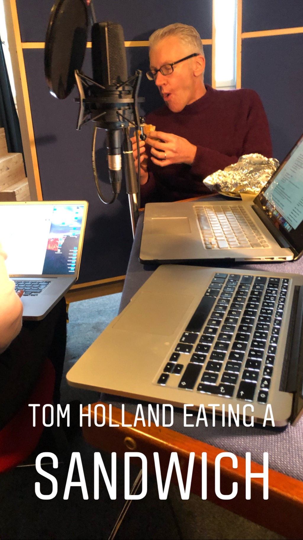 Tom Holland eats a sandwich
