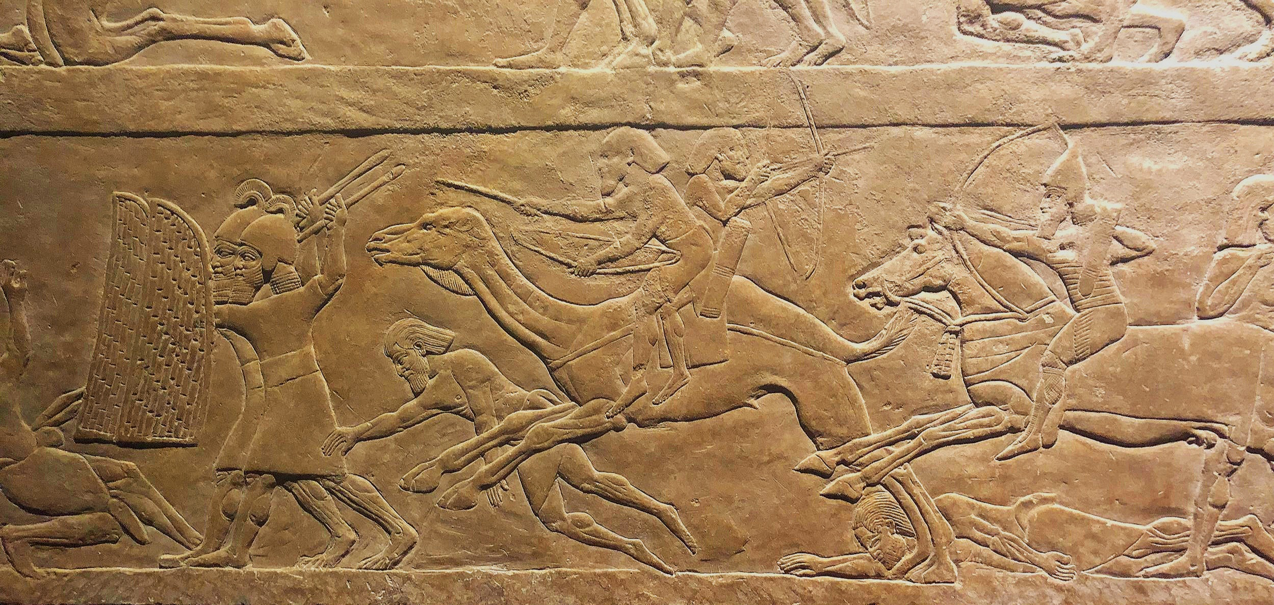Cowardly Egyptians on camels fleeing Ashurbanipal's mighty forces!