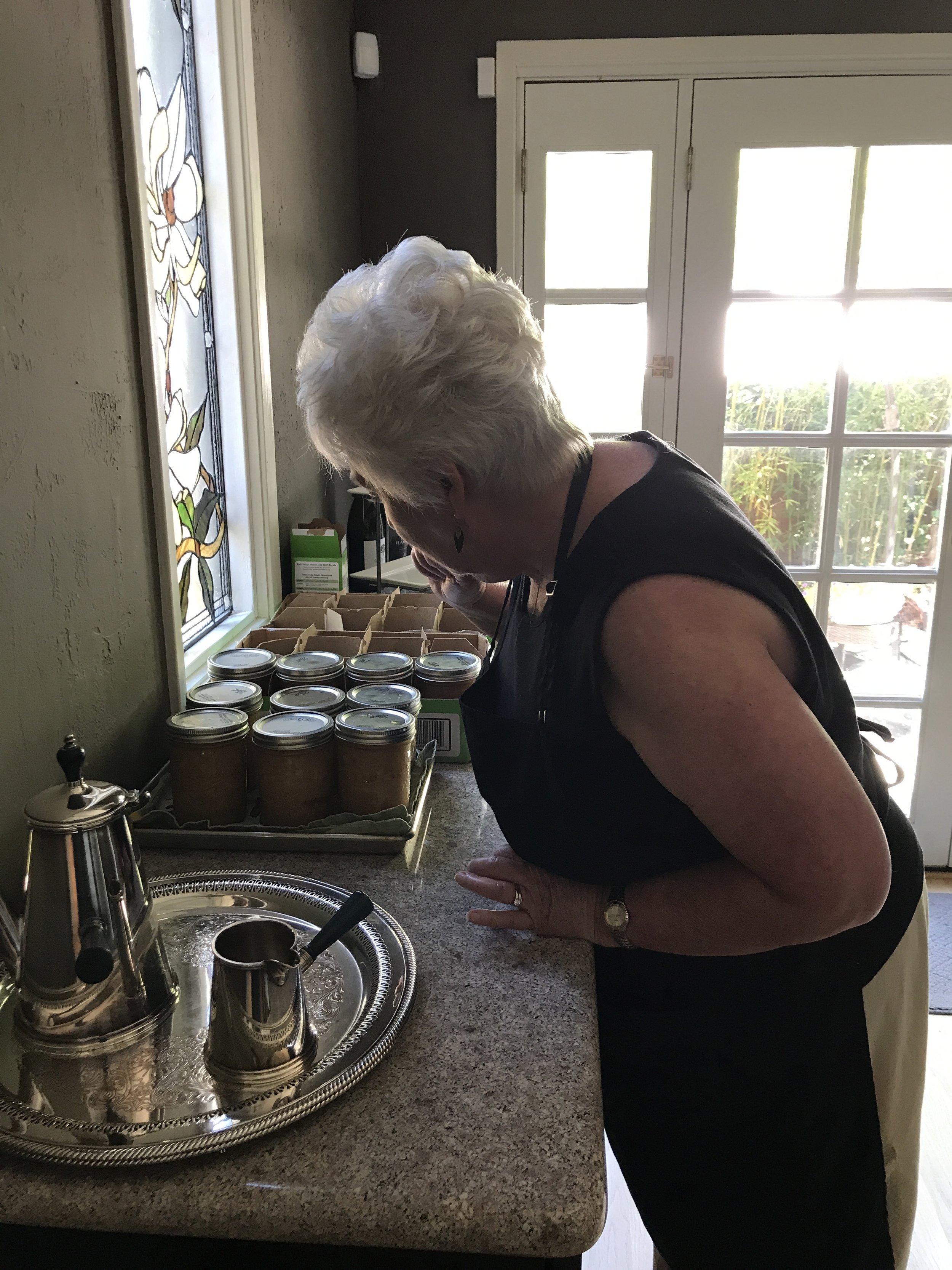 Julie checking our jars. Yum yum yum.