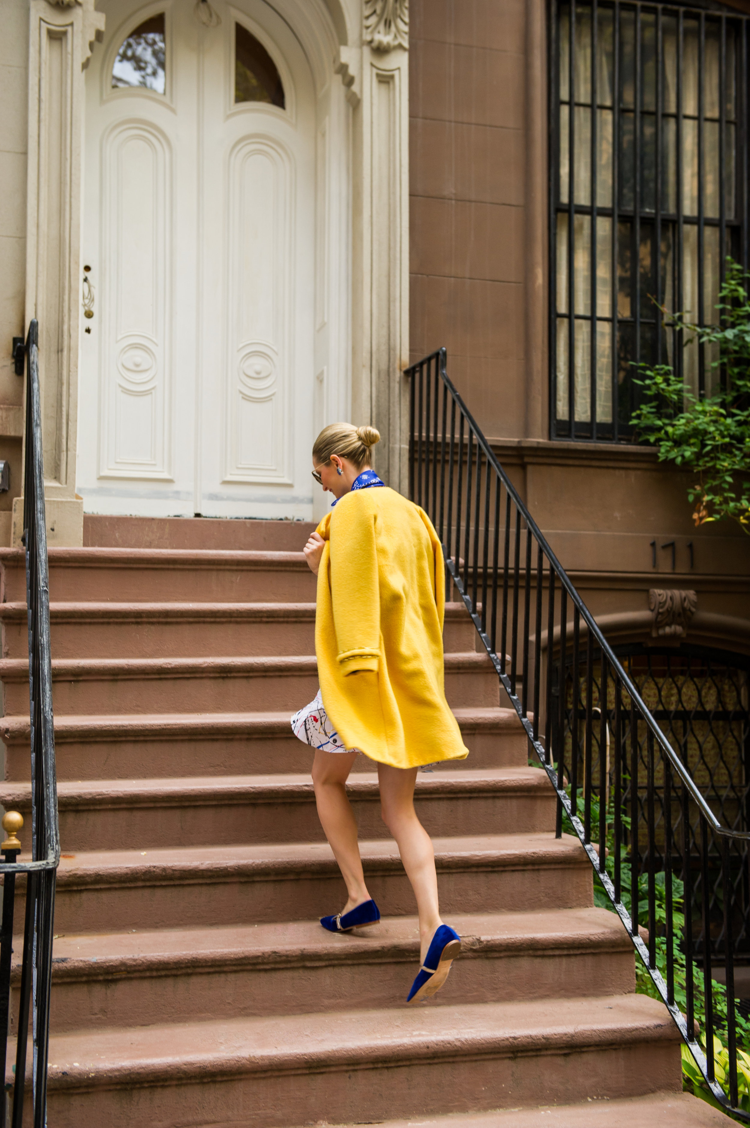 Leaping up the infamous brownstone's staircase