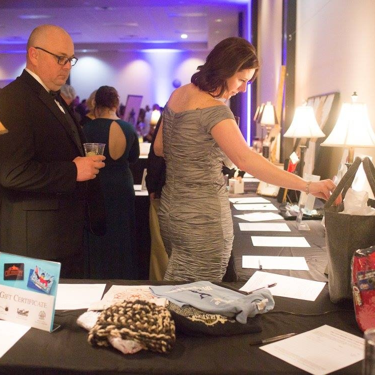 Silent Auction & Mardi Gras Ball   The Silent Auction is a NCLAC event that takes place during the Mardi Gras Ball. The purchases made at this event support NCLAC programming.