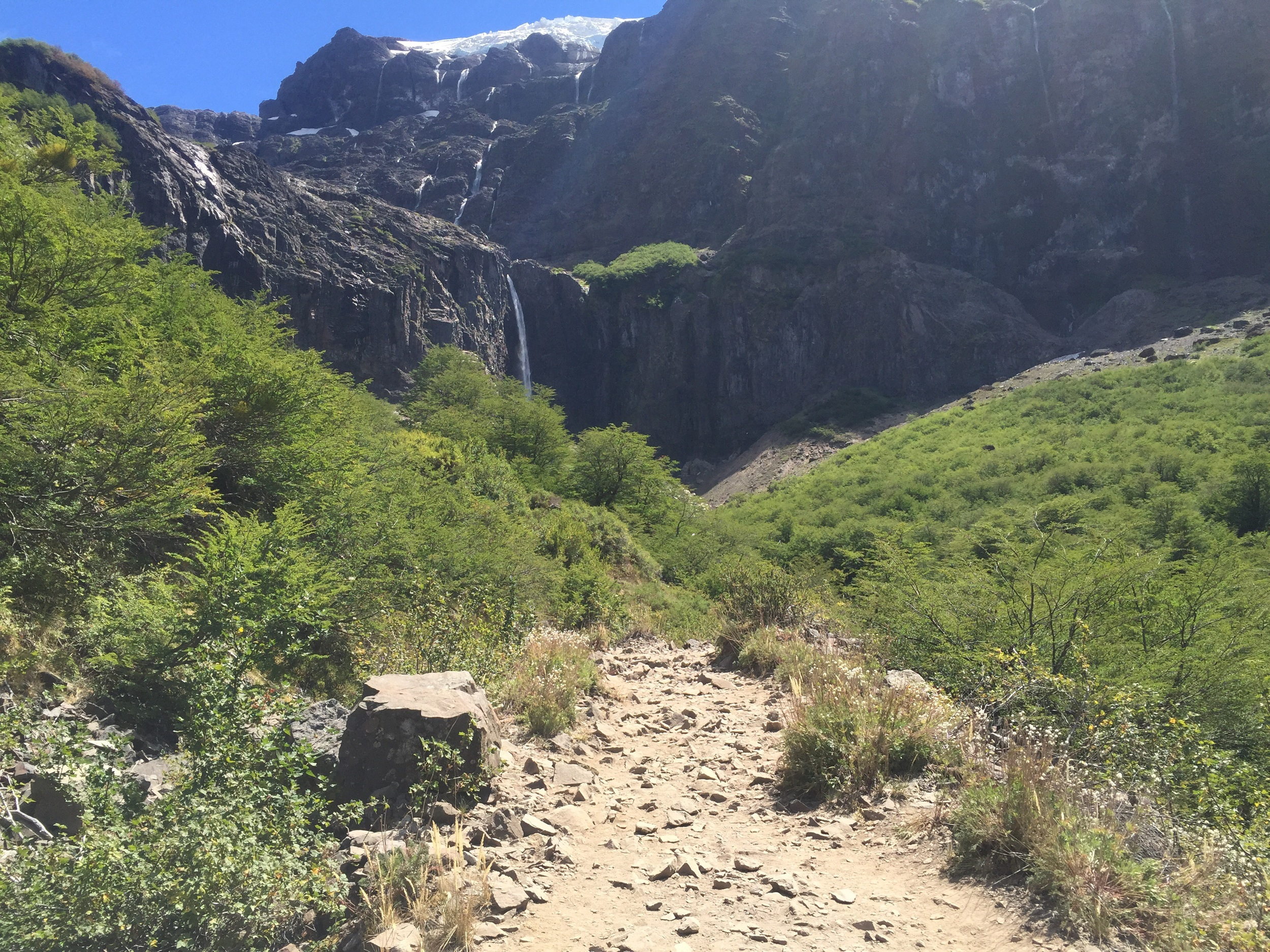 Hiking up to see glacial waterfalls.