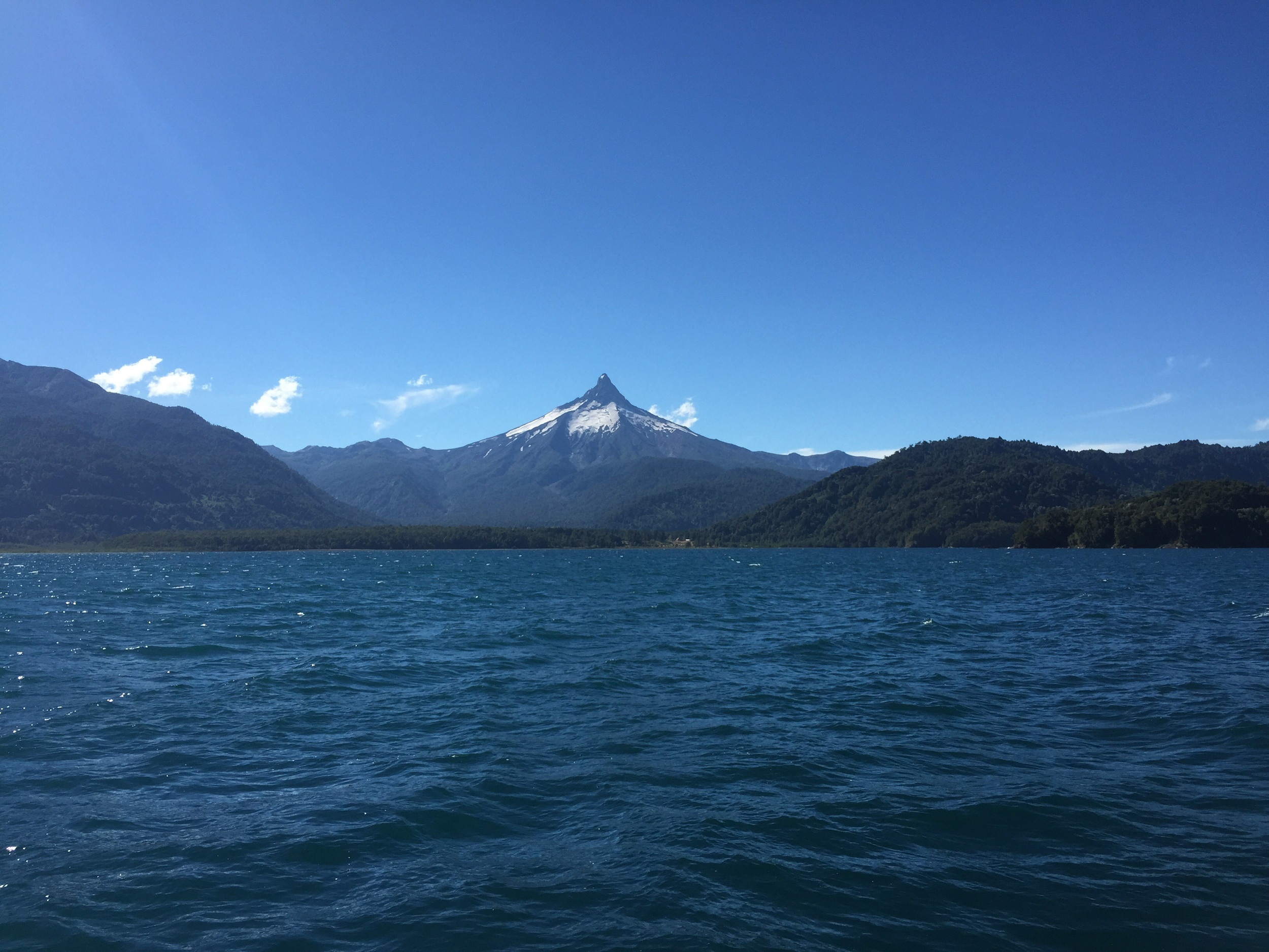 On board boat number three, and deep into Chile. This was the first volcano we saw, and it had eroded into this jagged peak like appearance.