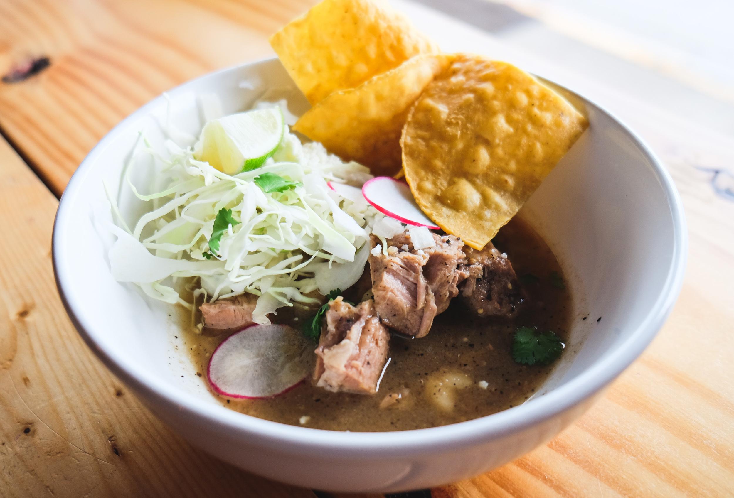Pozole Verde Bowl: Pork Shoulder, Roasted Tomatillo-Chile Poblano Broth, Radish, Cilantro, Cabbage, Lime,Queso Fresco, Tortilla Chips