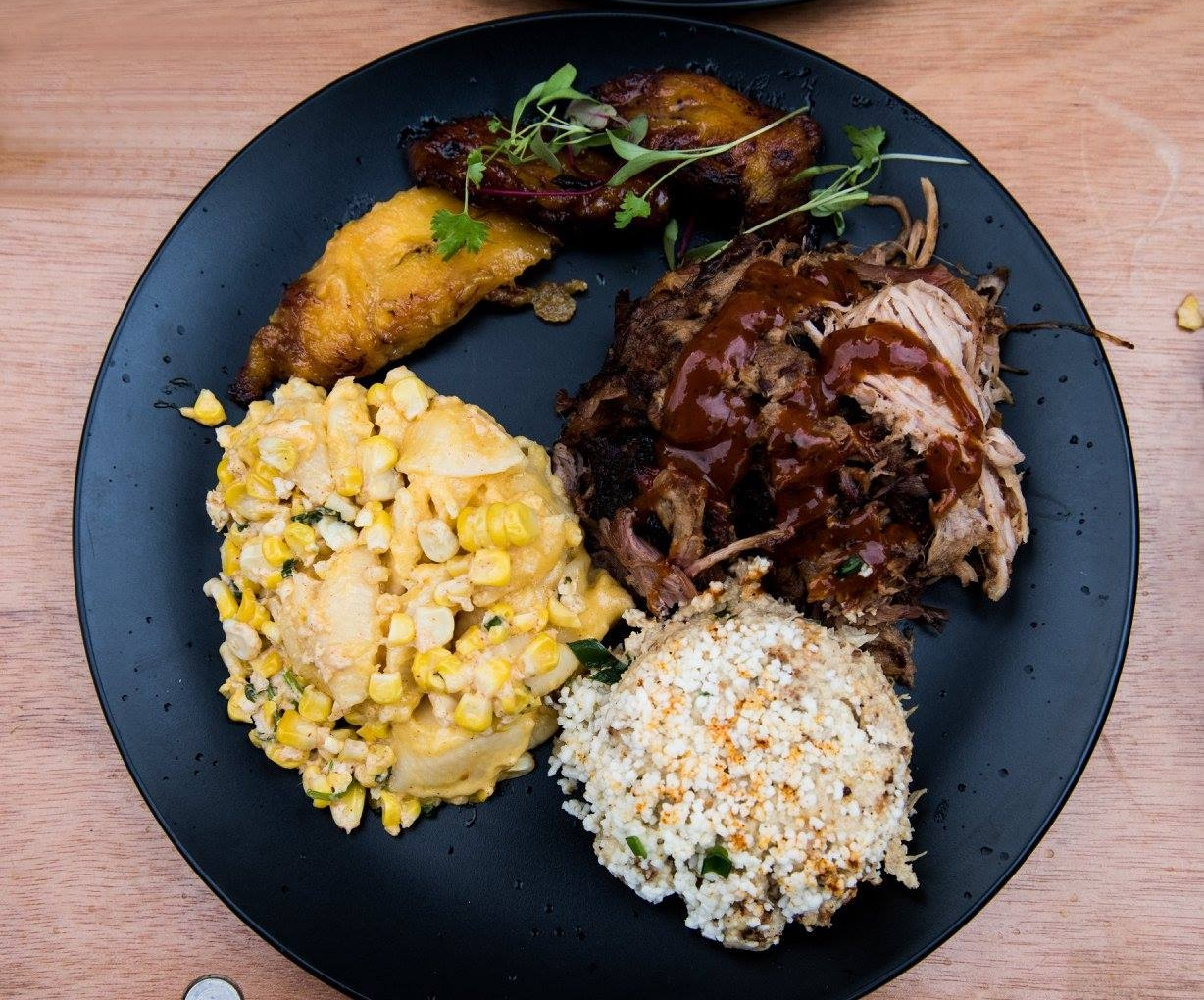 No one went home hungry after this delightful meal by  Pig Floyd's : Smoked Pork, Cauliflower Mash, Mexican Style Street Corn, & Plantains.