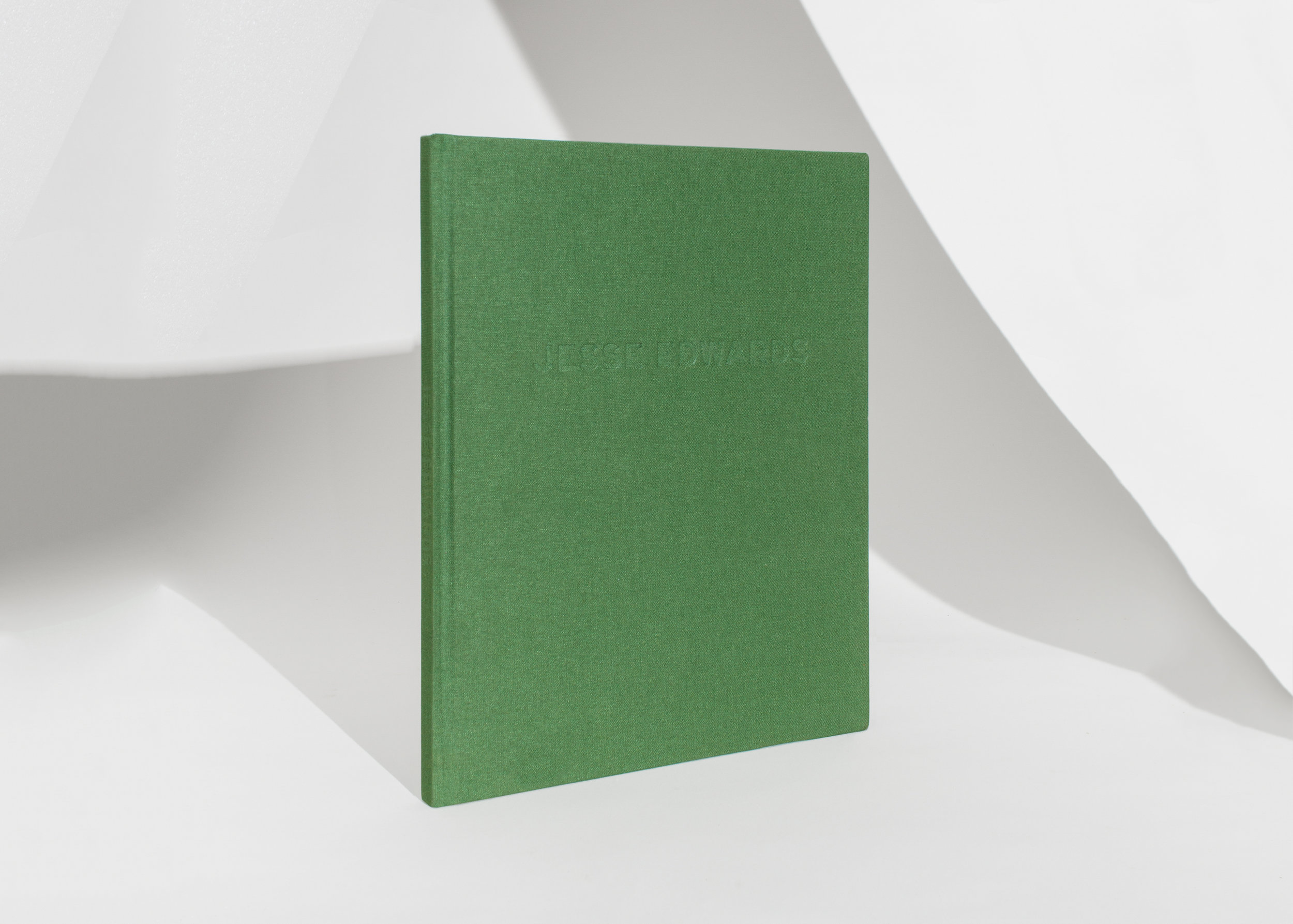 Jesse Edwards Monograph, by Jesse Edwards Published by Vito Schnabel Gallery 78 pg (Colour, Digital) 11 in x 9 in - 29 cm x 23 cm Hardcover - Perfect binding Green linen cover, blind deboss