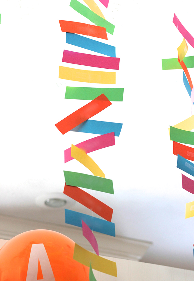 Get the siblings involved in making the party! These simple banners are made from paper rectangles taped onto white thread. Color infusion!!