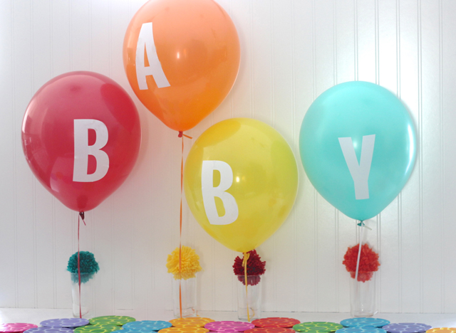 Add vinyl letters to basic balloons to say exactly what you want. Love these colors.