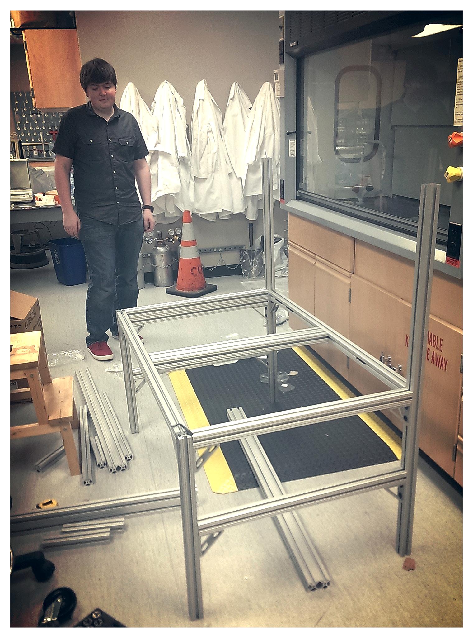 Ian admiring the sample prep cart-in-progress that he helped design.