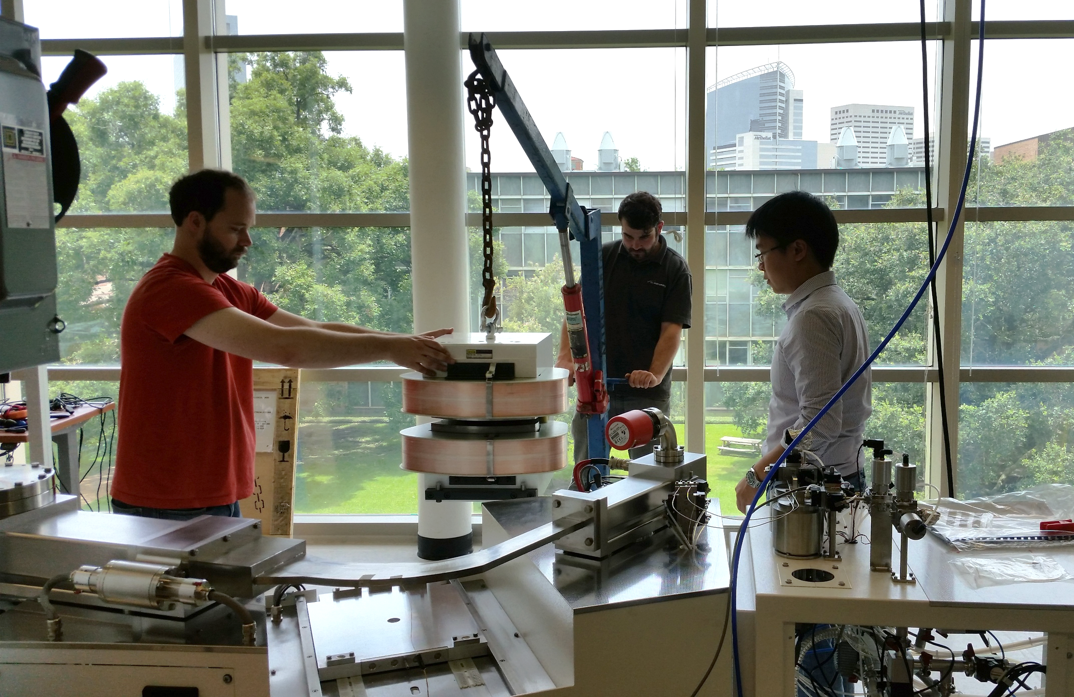 Loading the magnet onto the mass spectrometer. Left to right: Clint, Martin from Nu Instruments, and myself. Photo by Ian Mellor-Crummey.