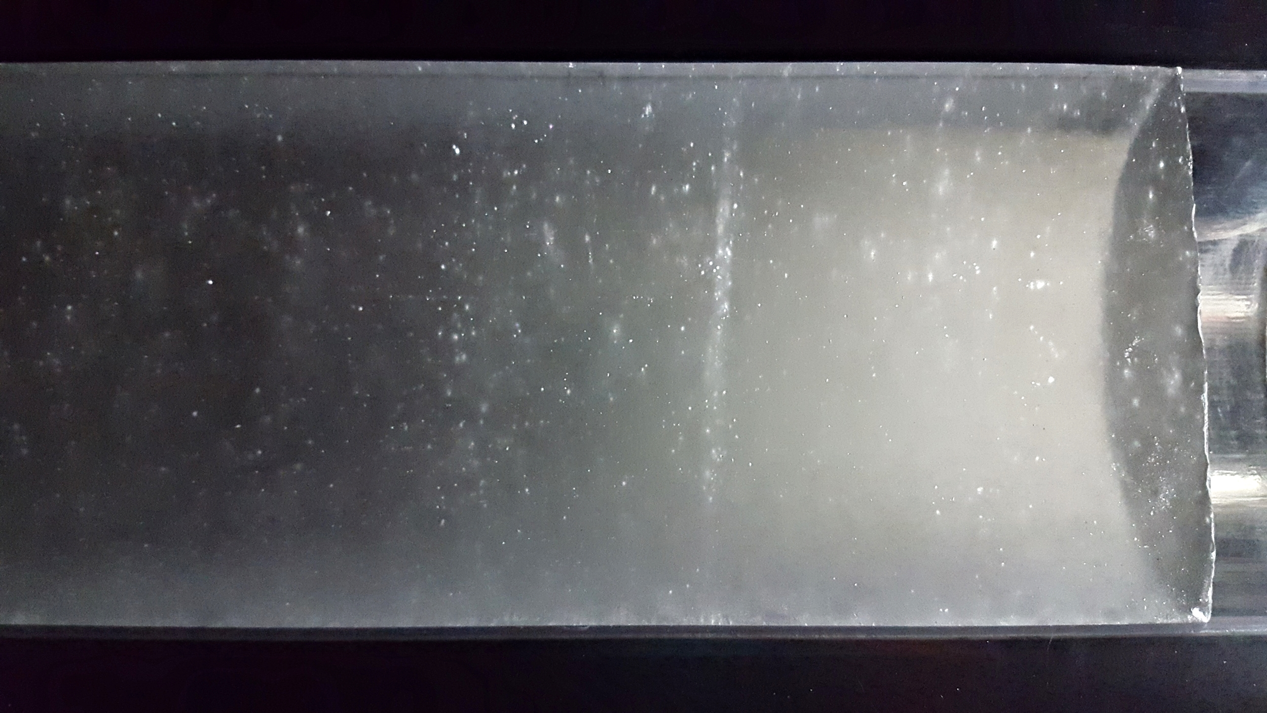 A deep ice core from West Antarctica in raking light. Note the line of bubbles, which are gases exsolving from the ice due to decompression, not unlike when you open a bottle of pop.