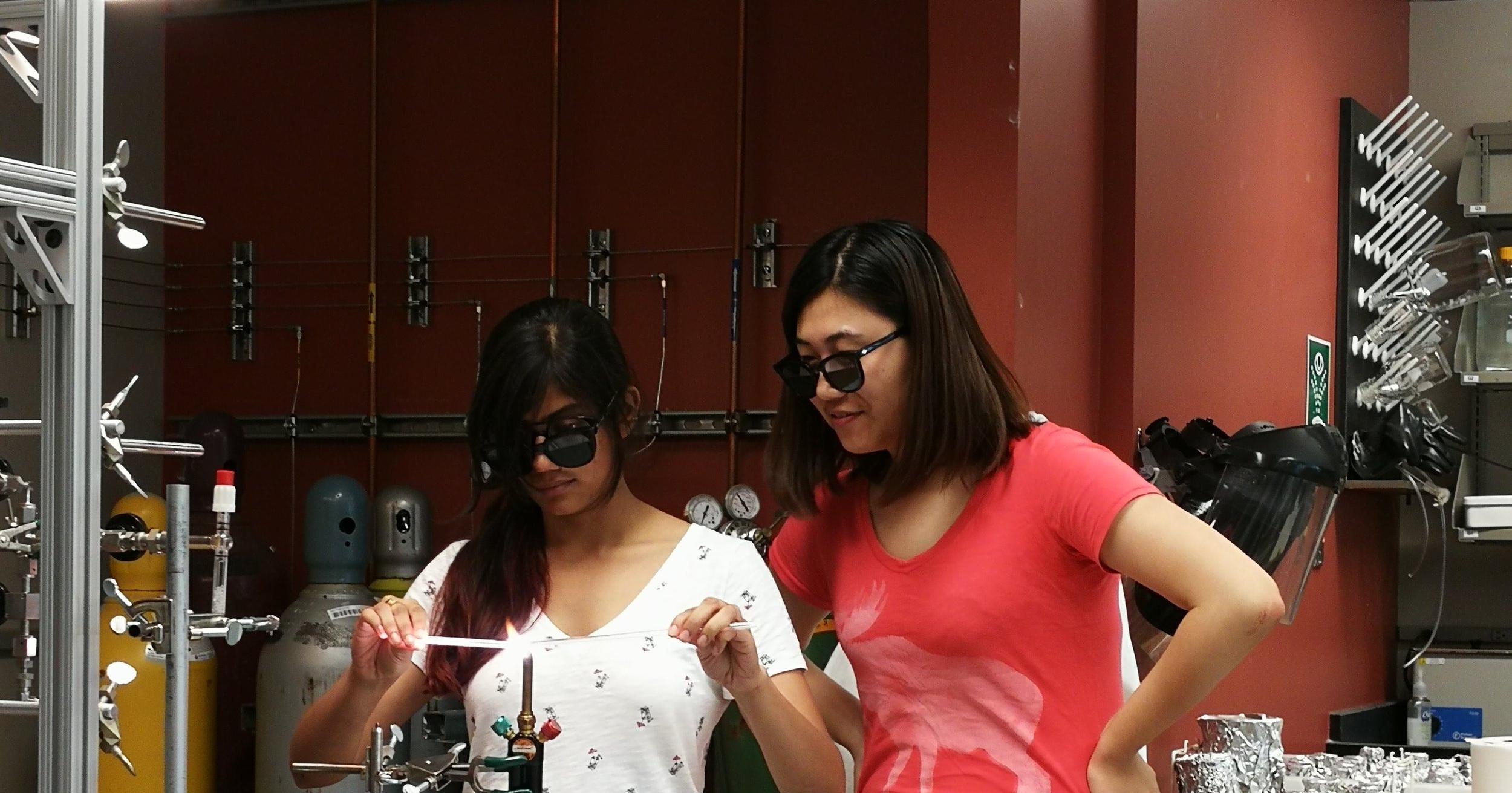 Huanting teaching Asmita how to make quartz glass breakseals (Photo by Tao Sun).