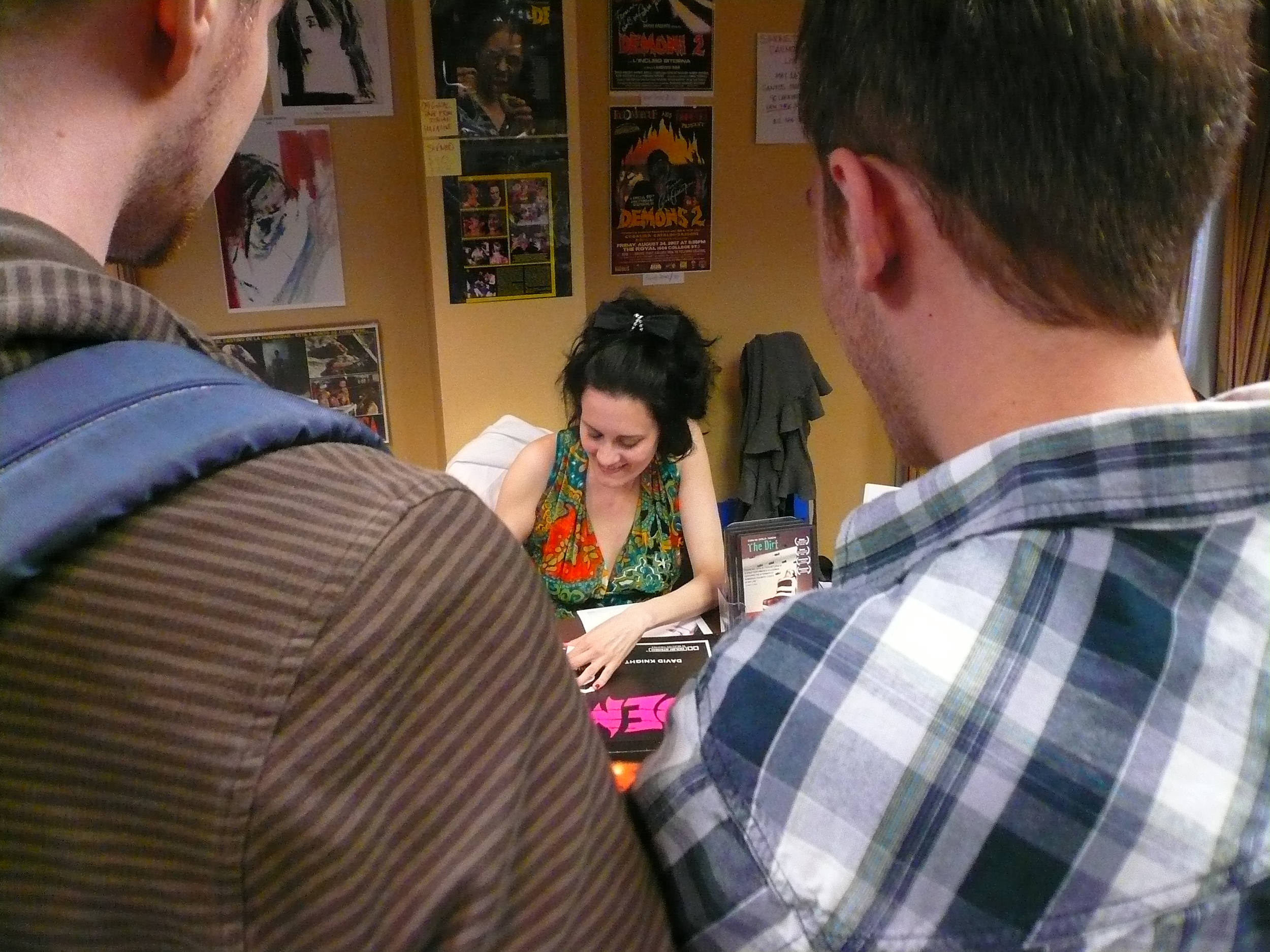 Coralina Cataldi-Tassoni signing book for the fans