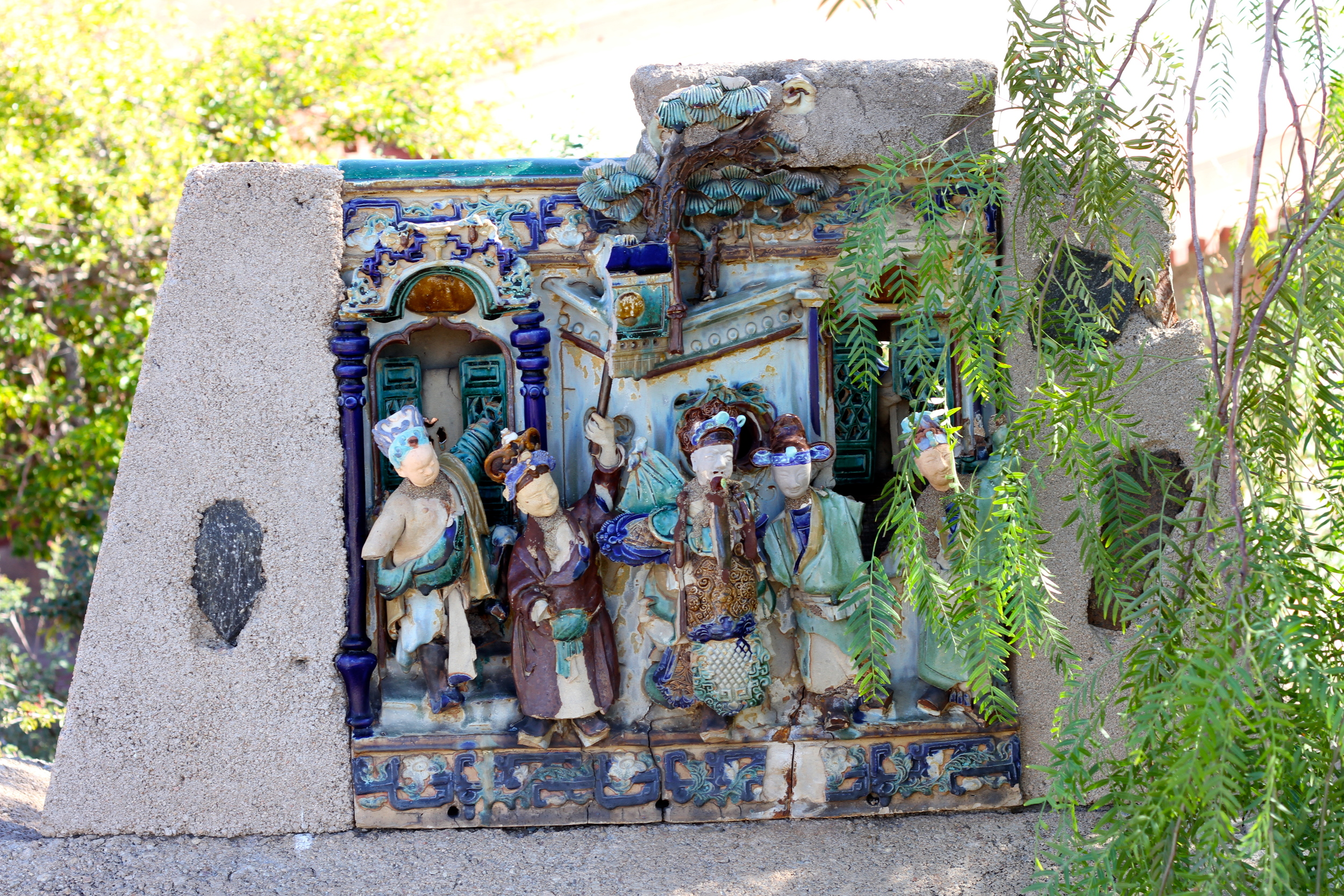 I spotted several of these ancient Chinese theater scenes, each one cemented into place throughout the property.