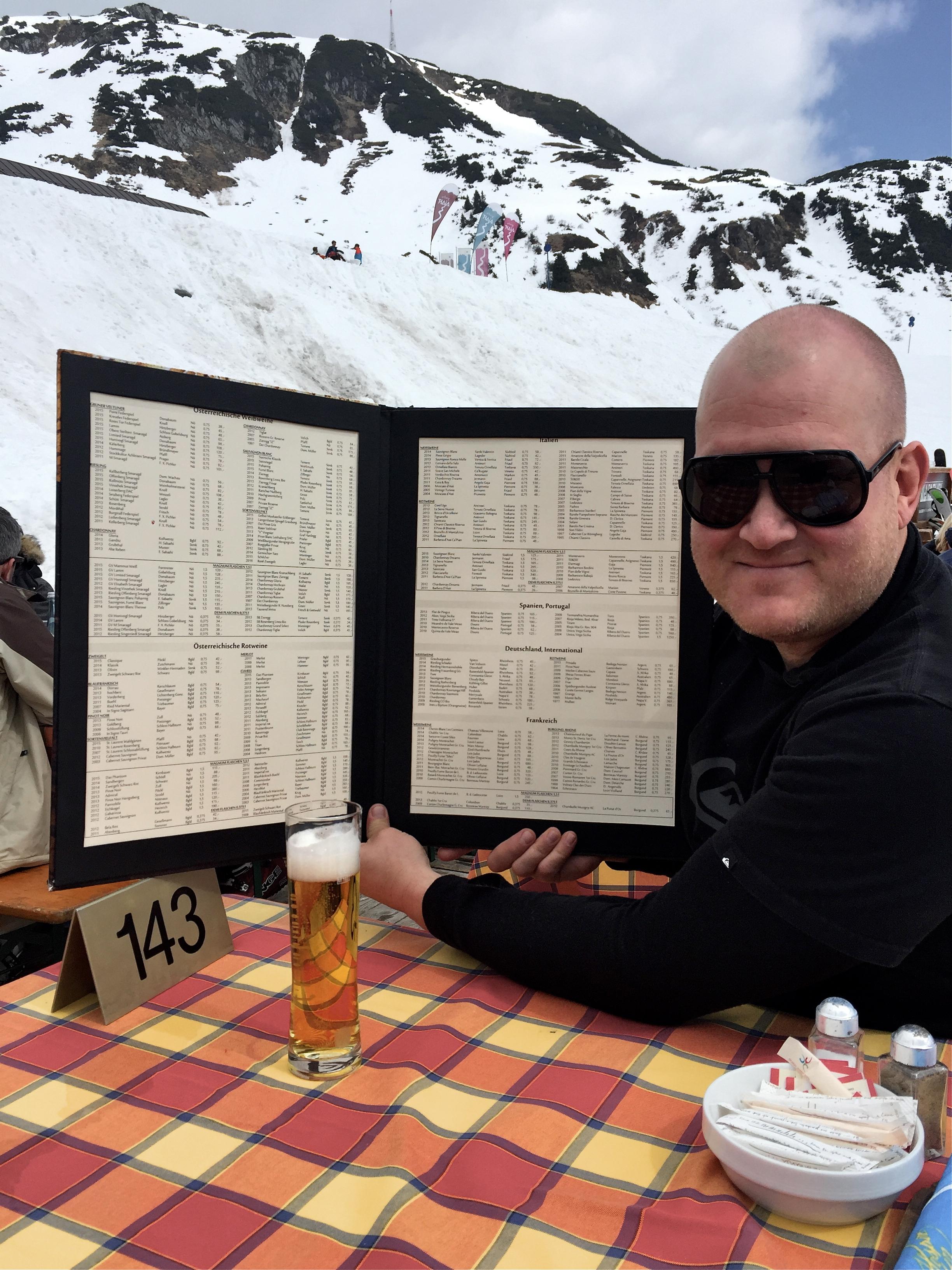 Dennis with the wine list at Hospiz Alm, St. Christof, Austria.