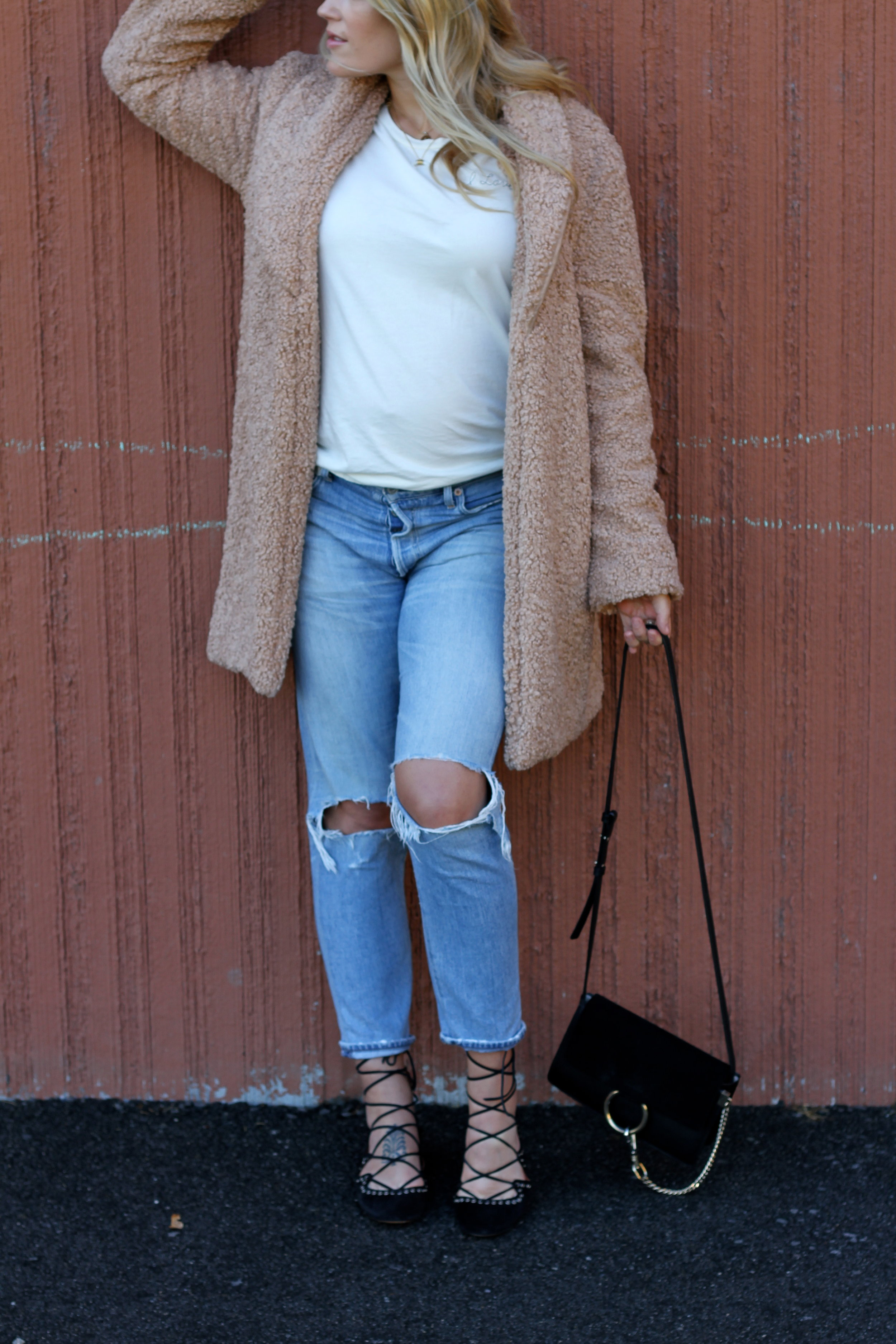 Pink Teddy Coat and Ripped Jeans.