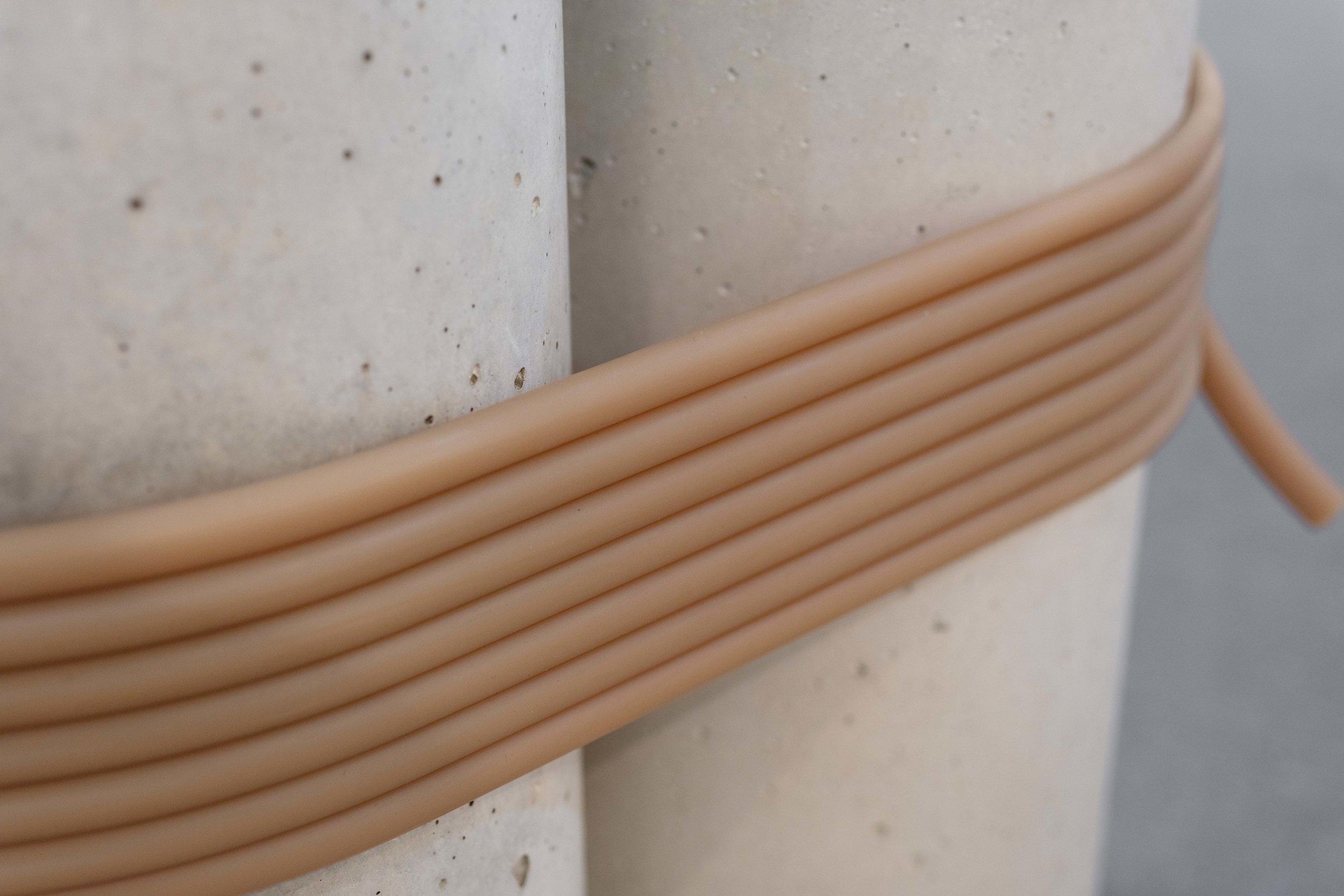 Tezontle,  Abrazo  , 2018. Pigmented concrete, rubber band, 120 x 60 x 60 cm. (47.2 x 23.6 x 23.6 in.)
