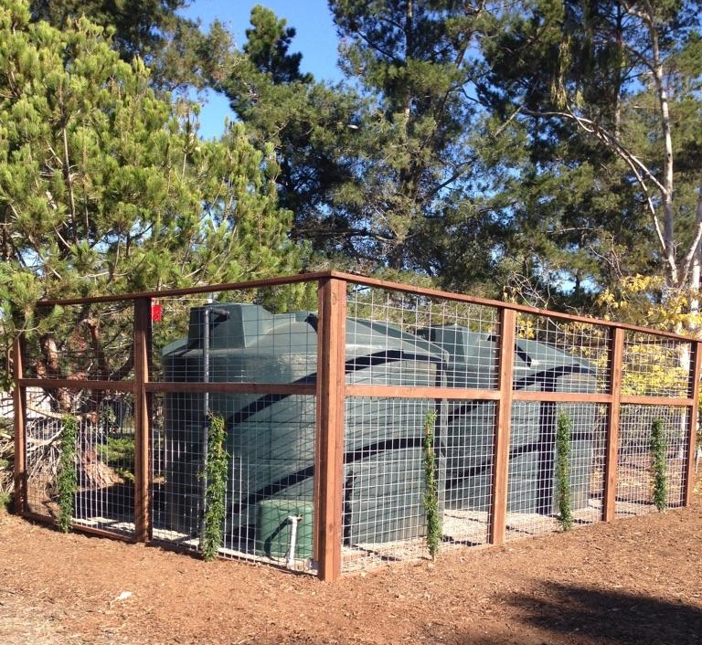 Two 5,000 Gallon Rain Tanks with Vine Trellis