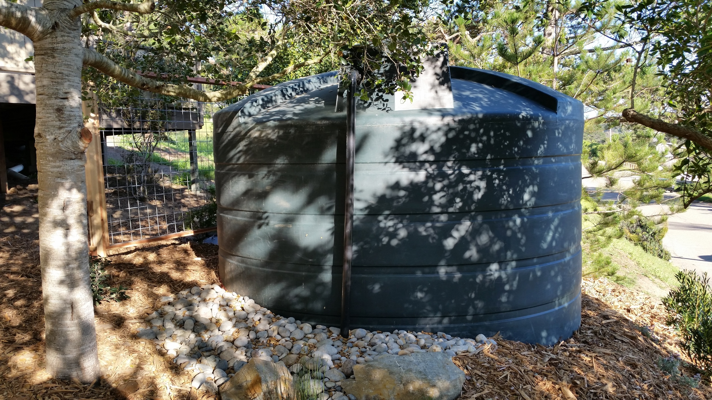 "This 5000 gallon Bushman rain tank was installed to catch the roof run-off of a home in Cambria. It filled up this spring on 4"" of rainfall alone and is the sole source of outdoor irrigation water used in the gardens. 1000 sq ft of roof top yields approx. 600 gallons of water to store per 1"" of rain."