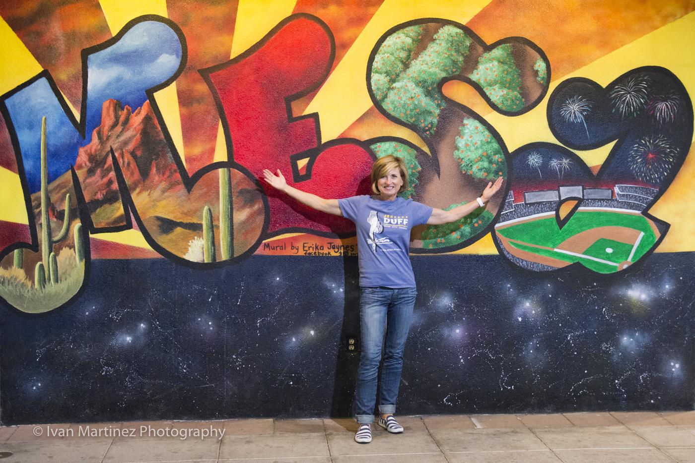 Jen Duff loves Mesa. Downtown Mural by artist, Erika Jaynes. Photo by Ivan Martinez Photography.