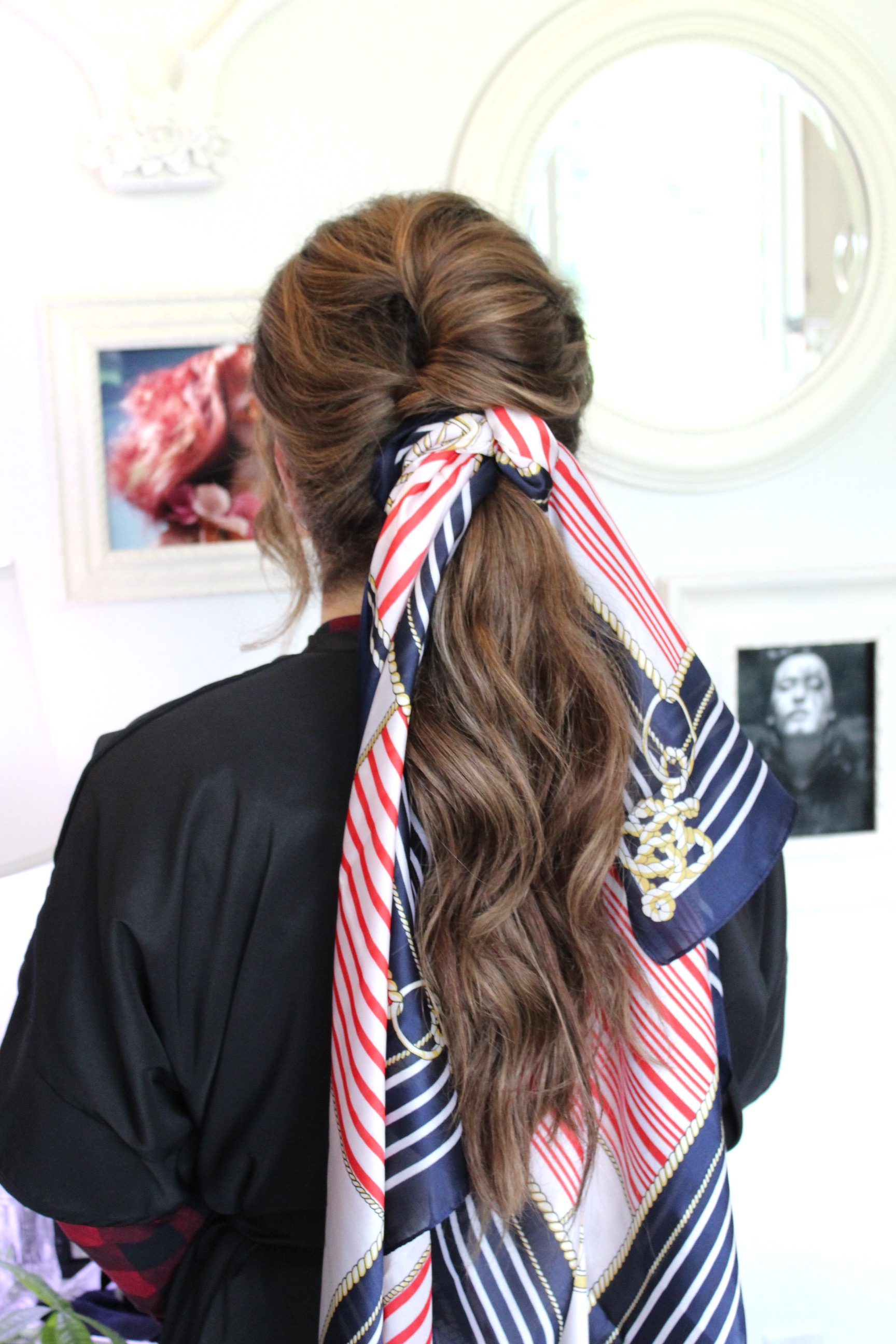 One of my favorite, easy ways to sass up an easy summer style- silk scarves. Make sure they're real silk- it grips and makes a much more secure knot than synthetic fabric.