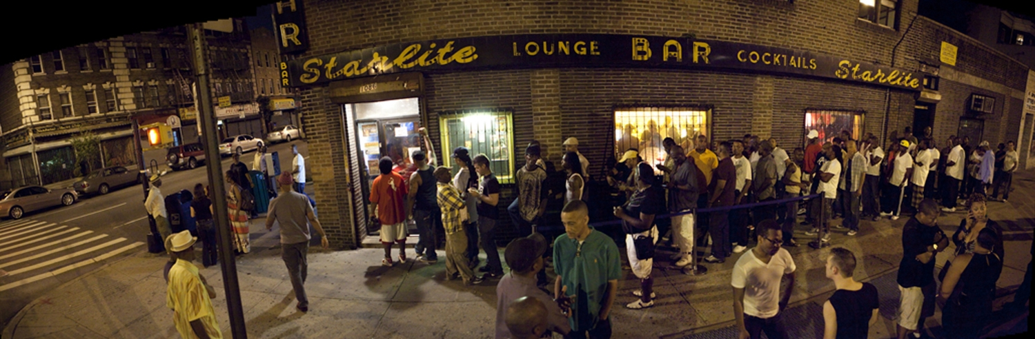 panoramic image of the Starlite's exterior with a line down the block