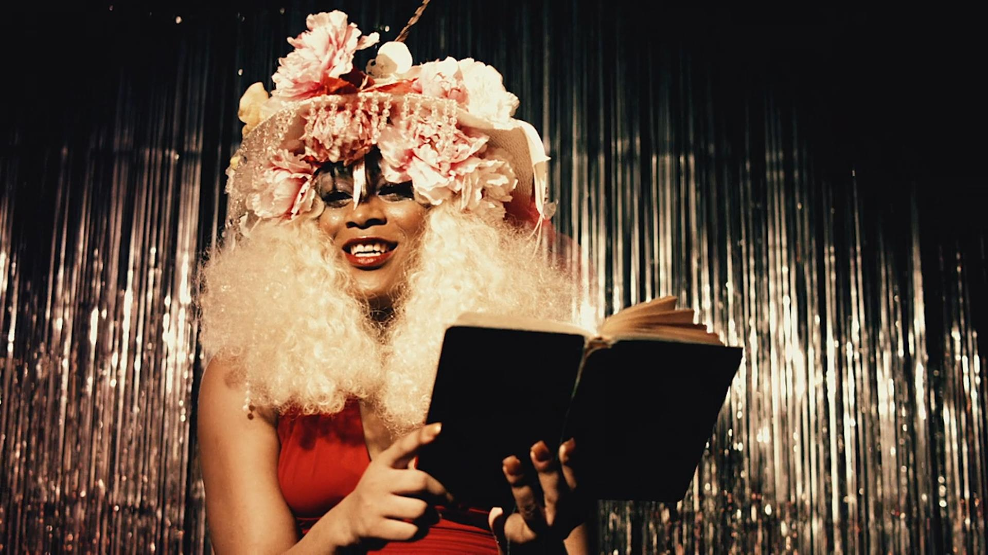 Image Description: Marsha P Johnson (Mya Taylor) performs a poem on stage