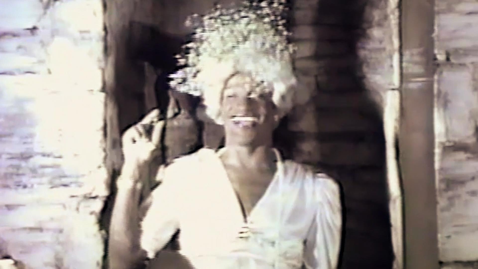 Image Description: Black and white archival video of Marsha P Johnson