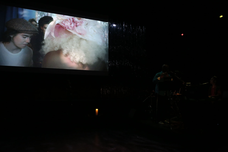 the film screens in a dark room