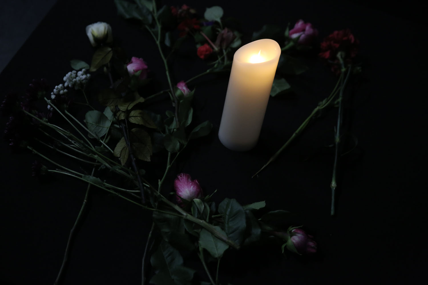 a candle and flowers