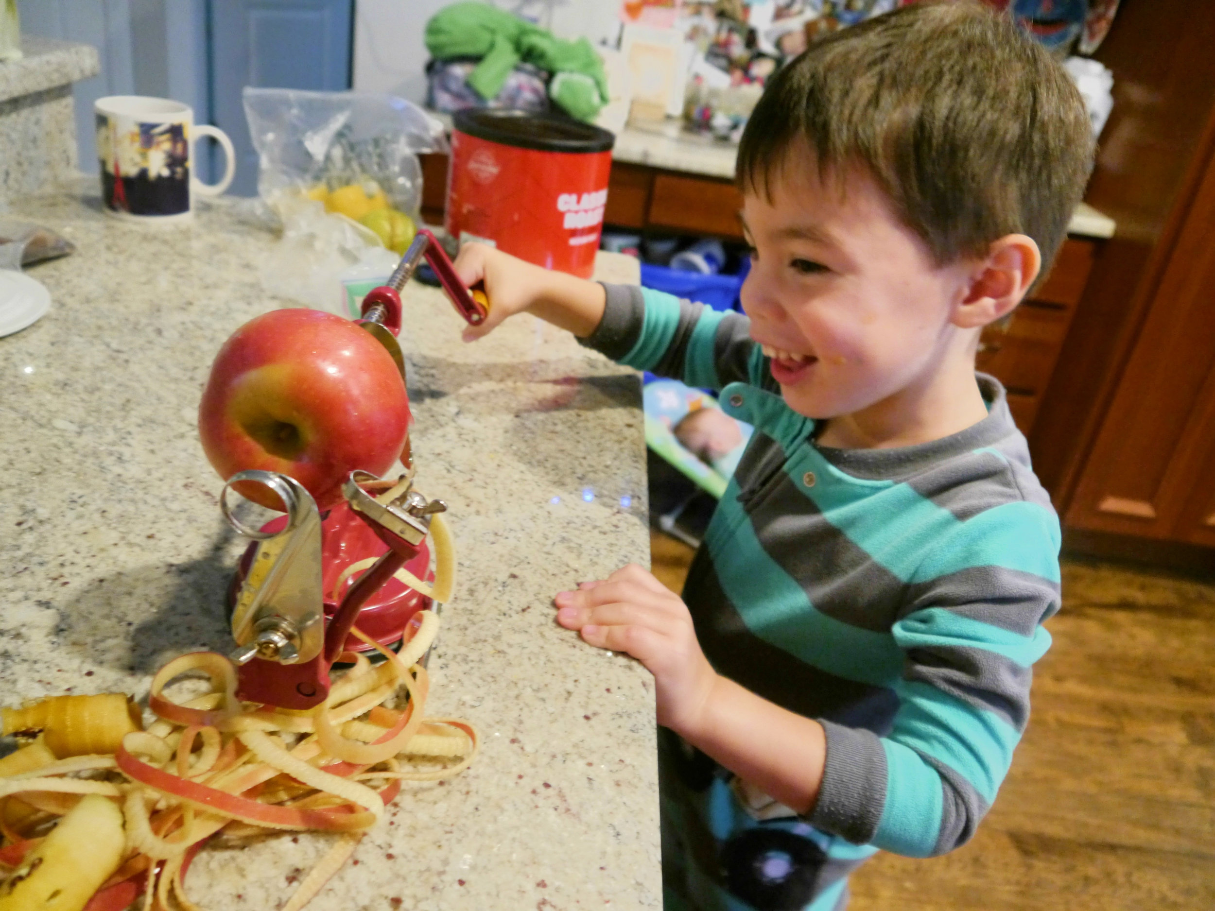 """A few years ago I bought this apple corer, peeler, slicer, which is one of the few uni-taskers allowed in my kitchen. I'm so glad I have it. This was Emmett's first time using it and he thoroughly enjoyed the experience. Isla was able to use it too (little miss """"anything you can do I can do better"""" - she's a competitive little bugger). They made quick work of 4 apples."""