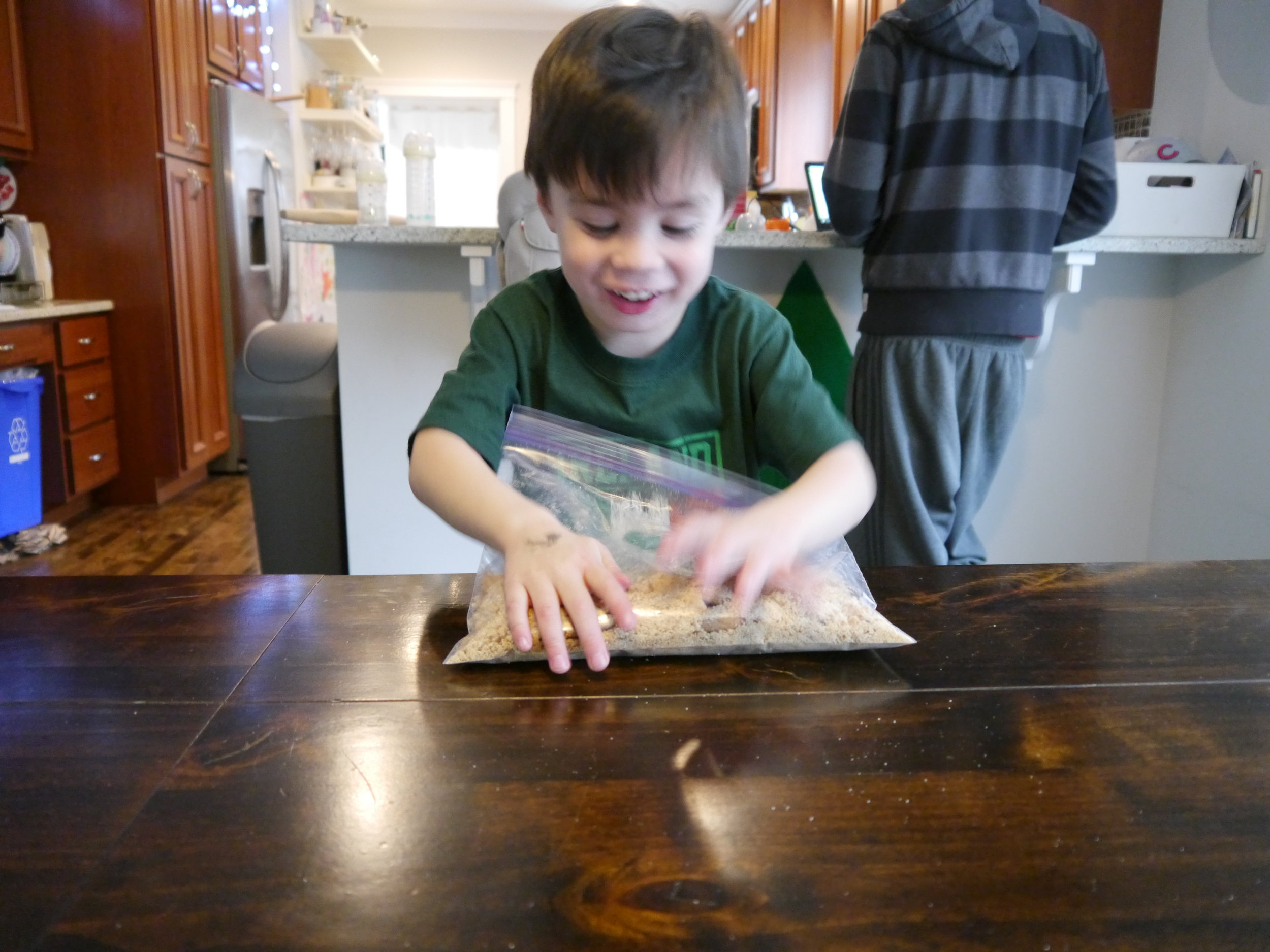 He flung the rolling pin aside and got in there with his hands.