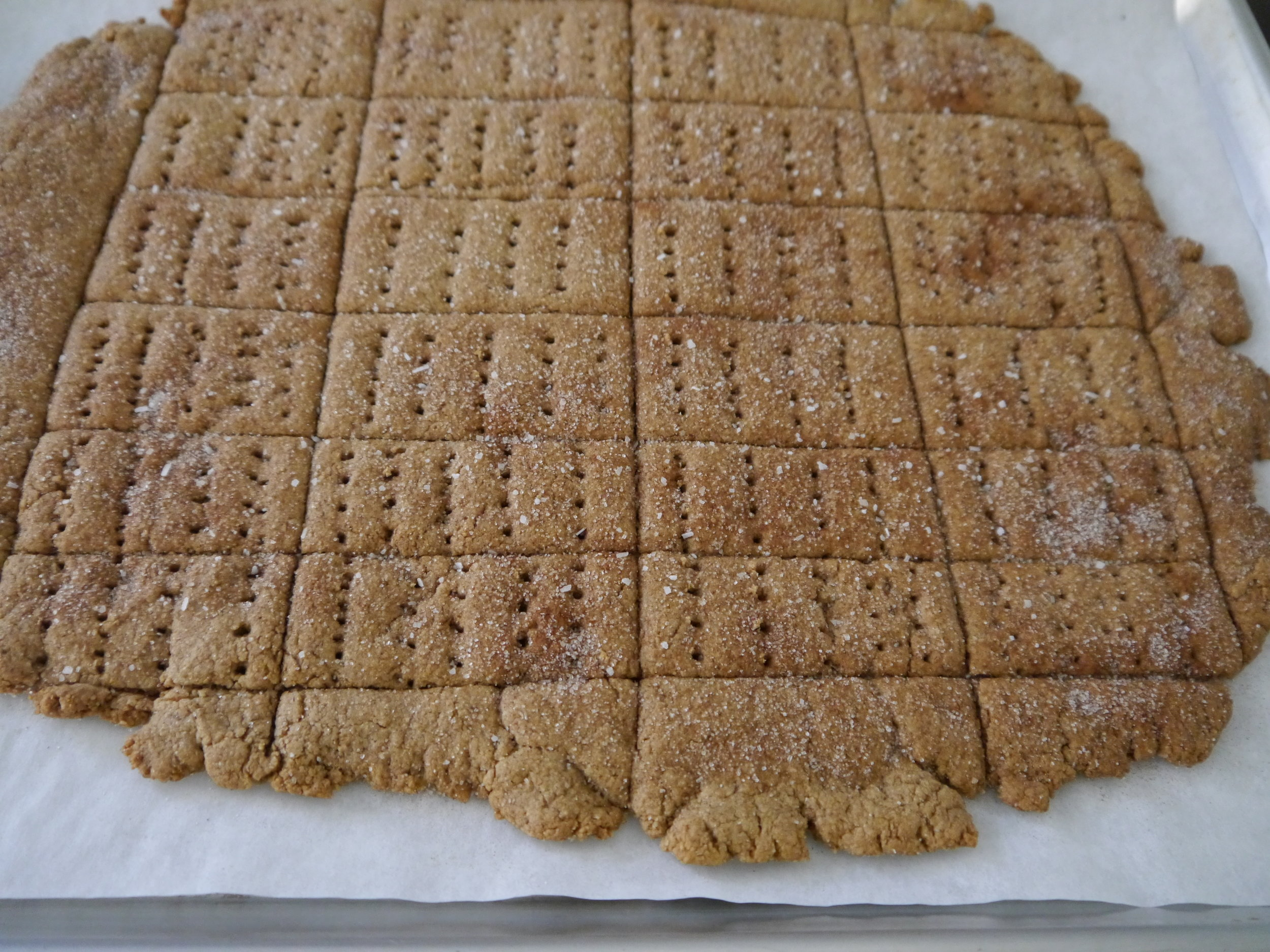 Bake the grahams until the edges are dark golden brown and the center is dry and set, 17 to 20 minutes. Cool completely on the sheet on a wire rack, then break into crackers along the cut lines.