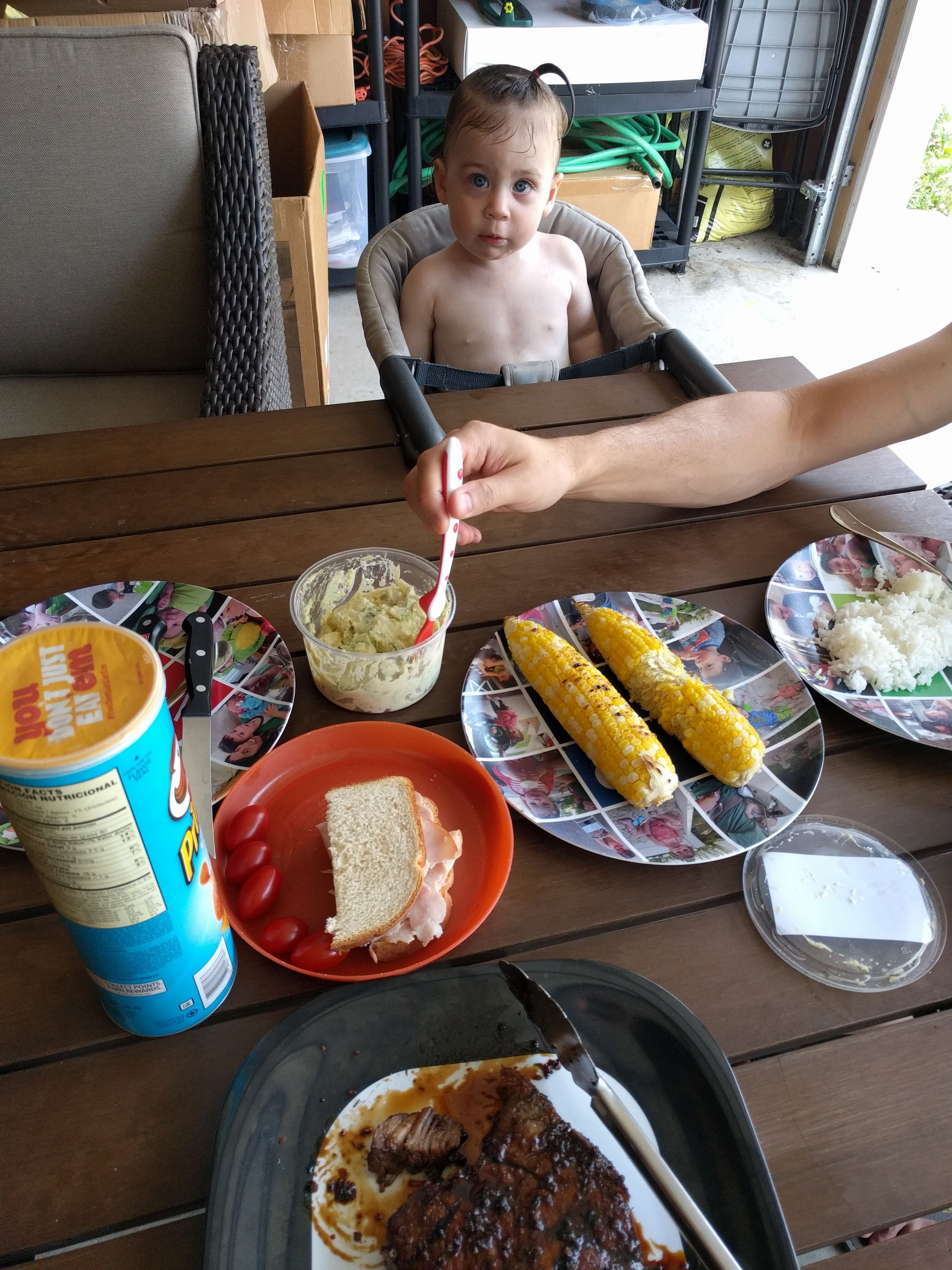 We put our patio umbrella over the kiddie pool so we ate lunch in the shade of the garage.Happy to report that Emmett eschewed his ham sandwich for the jerk pork. Fly the W! Home Cooking 1: Toddler Diet 0.