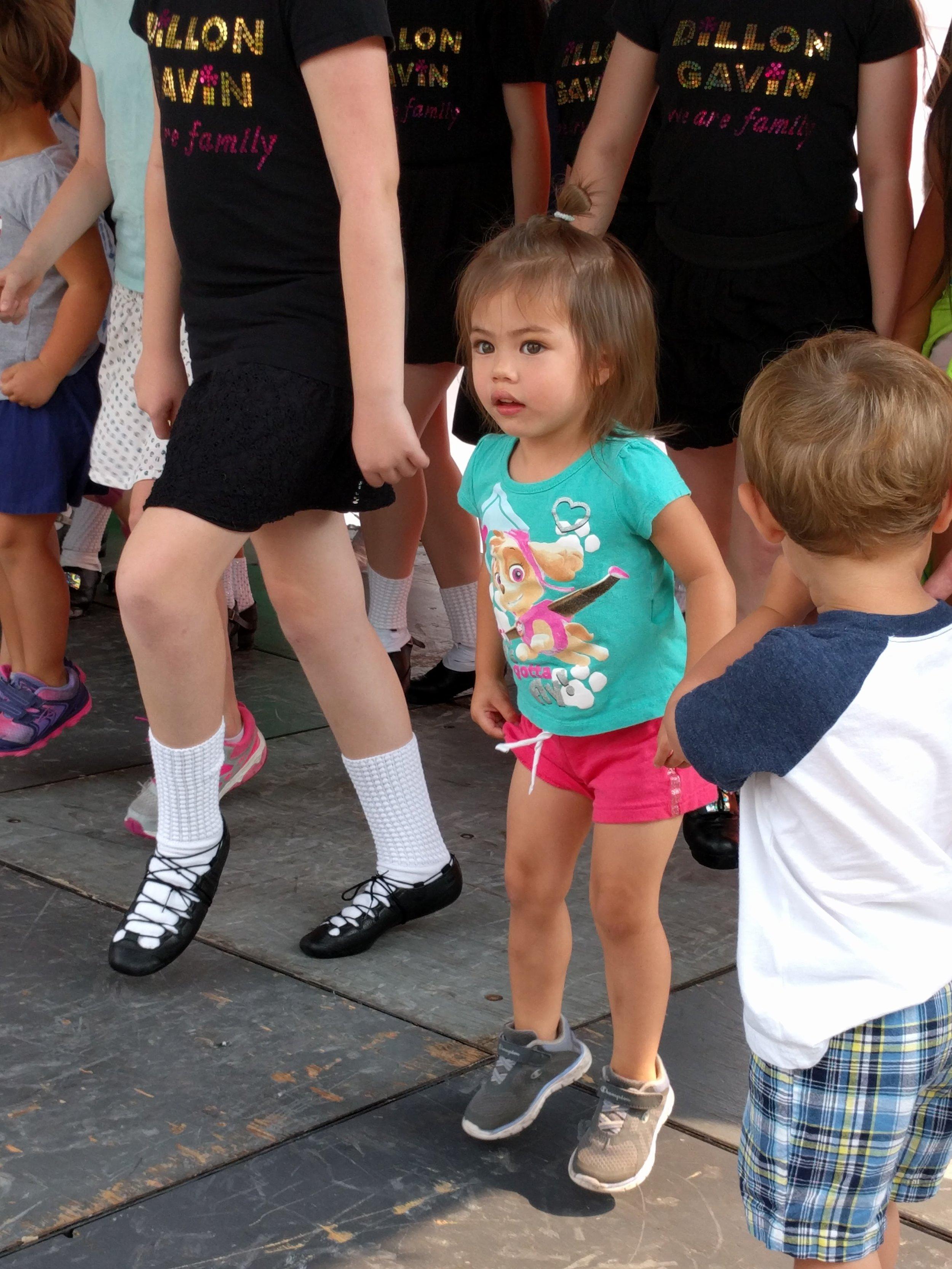 Isla taking in an Irish dance lesson on the stage at Irish Days.