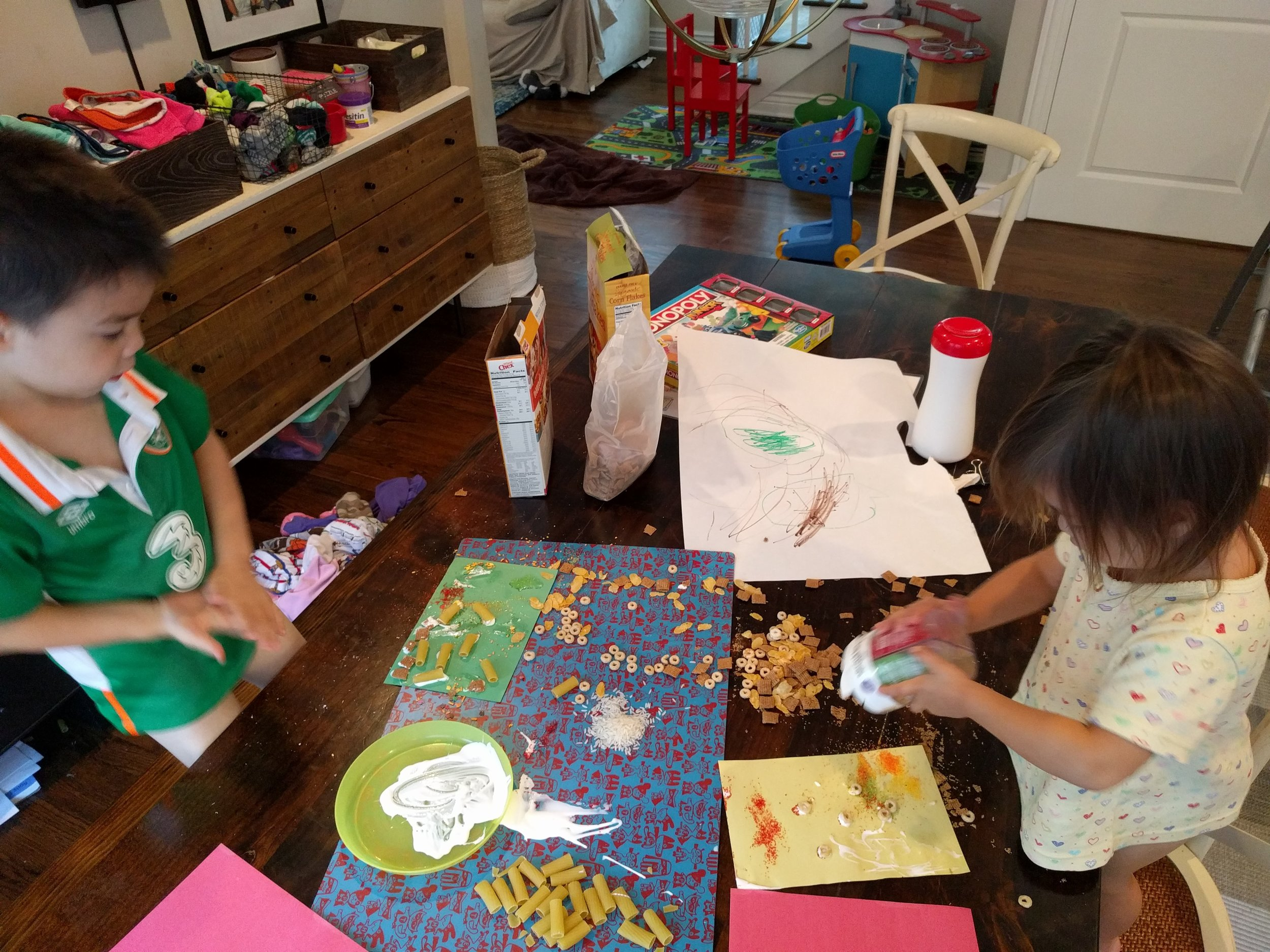 Crafting with modge podge, the last of an old box of rigatoni, stale cereal and sprinkles while I bake.  Later - they ate their art. I wish I was kidding.