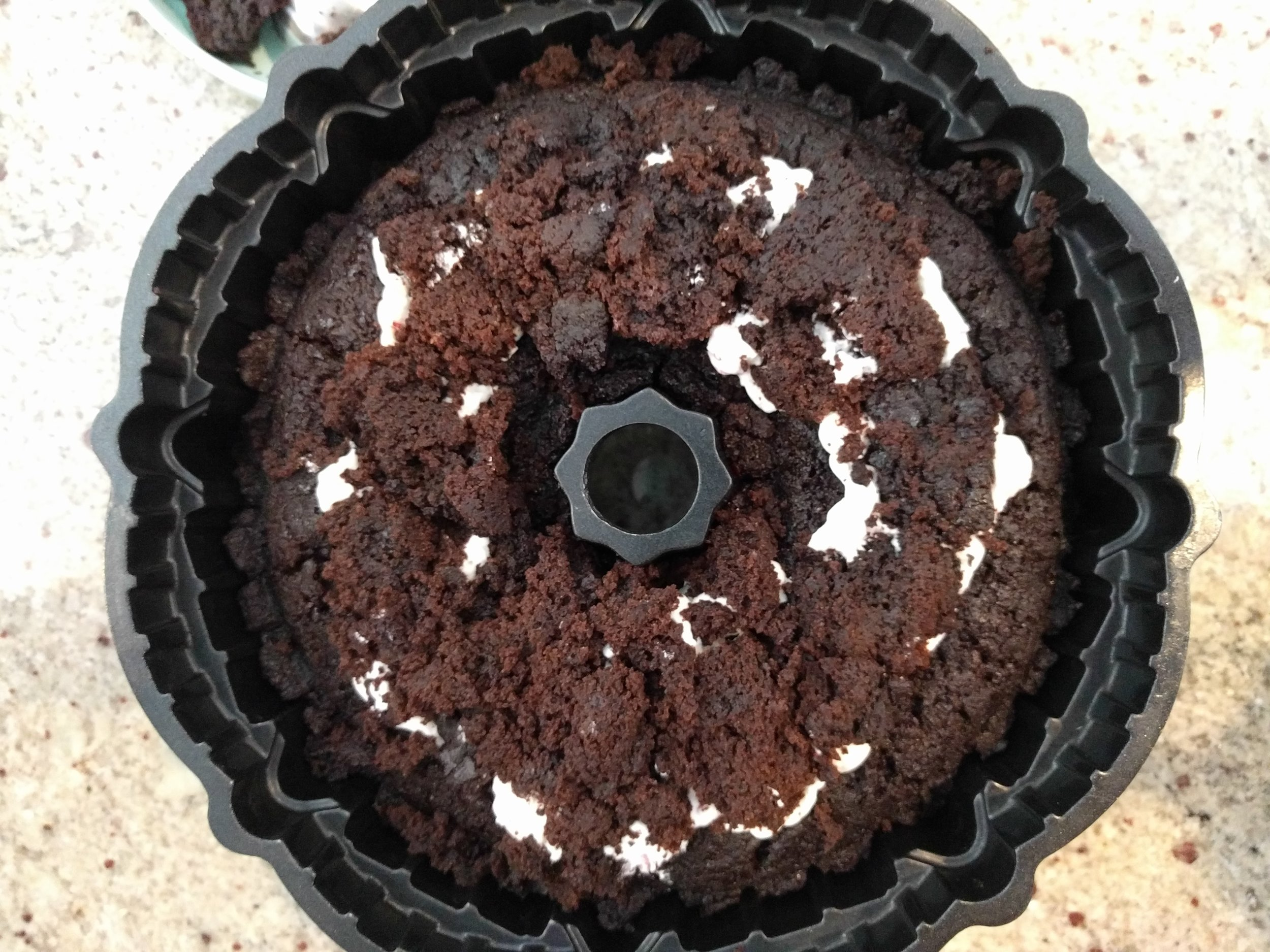If you want, thought it's not necessary, you can cover the filling with some of the cake pieces you took out.