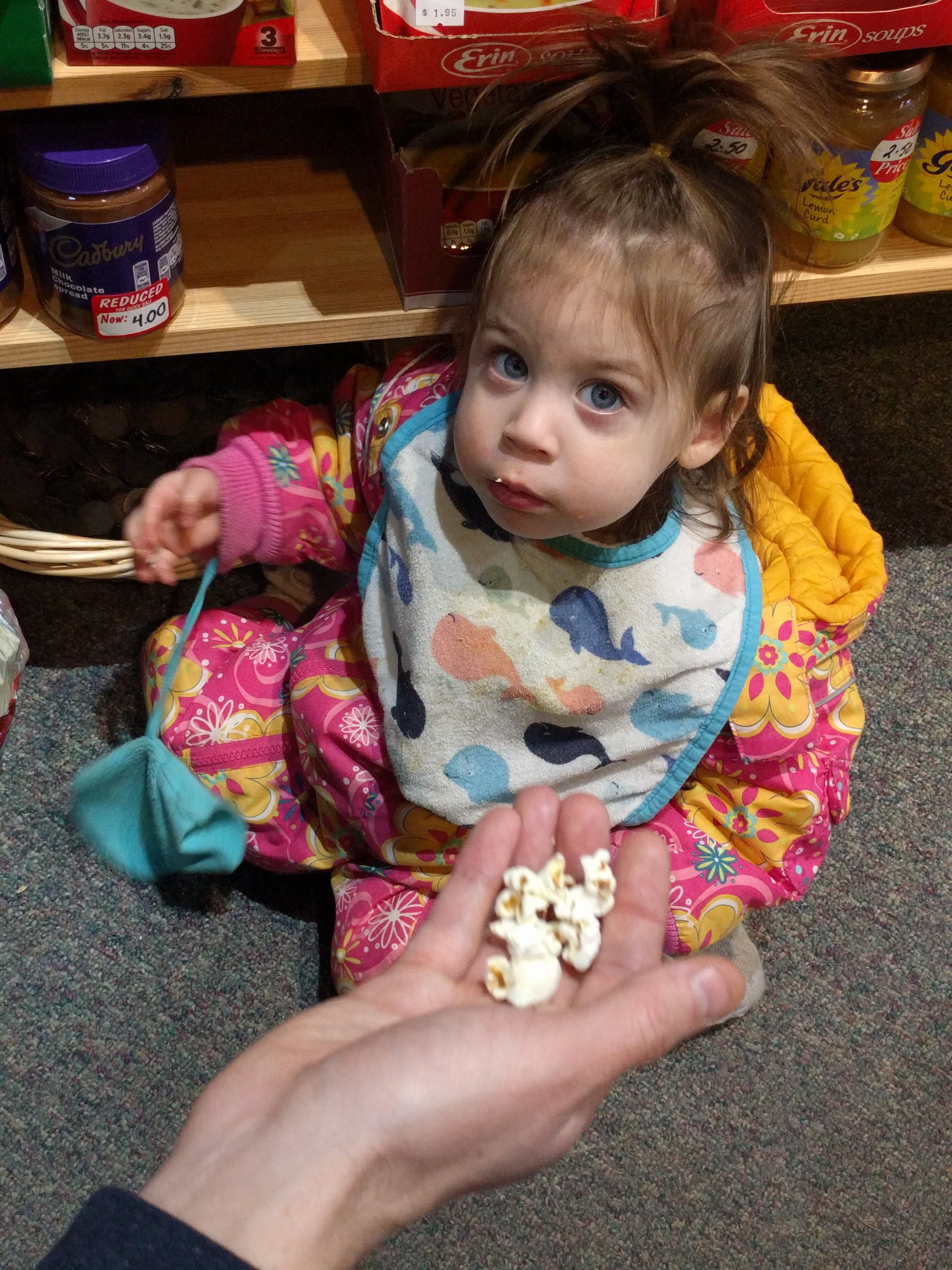 Sampling all of the snacks. Hot and spicy Monster Munch was her favorite.