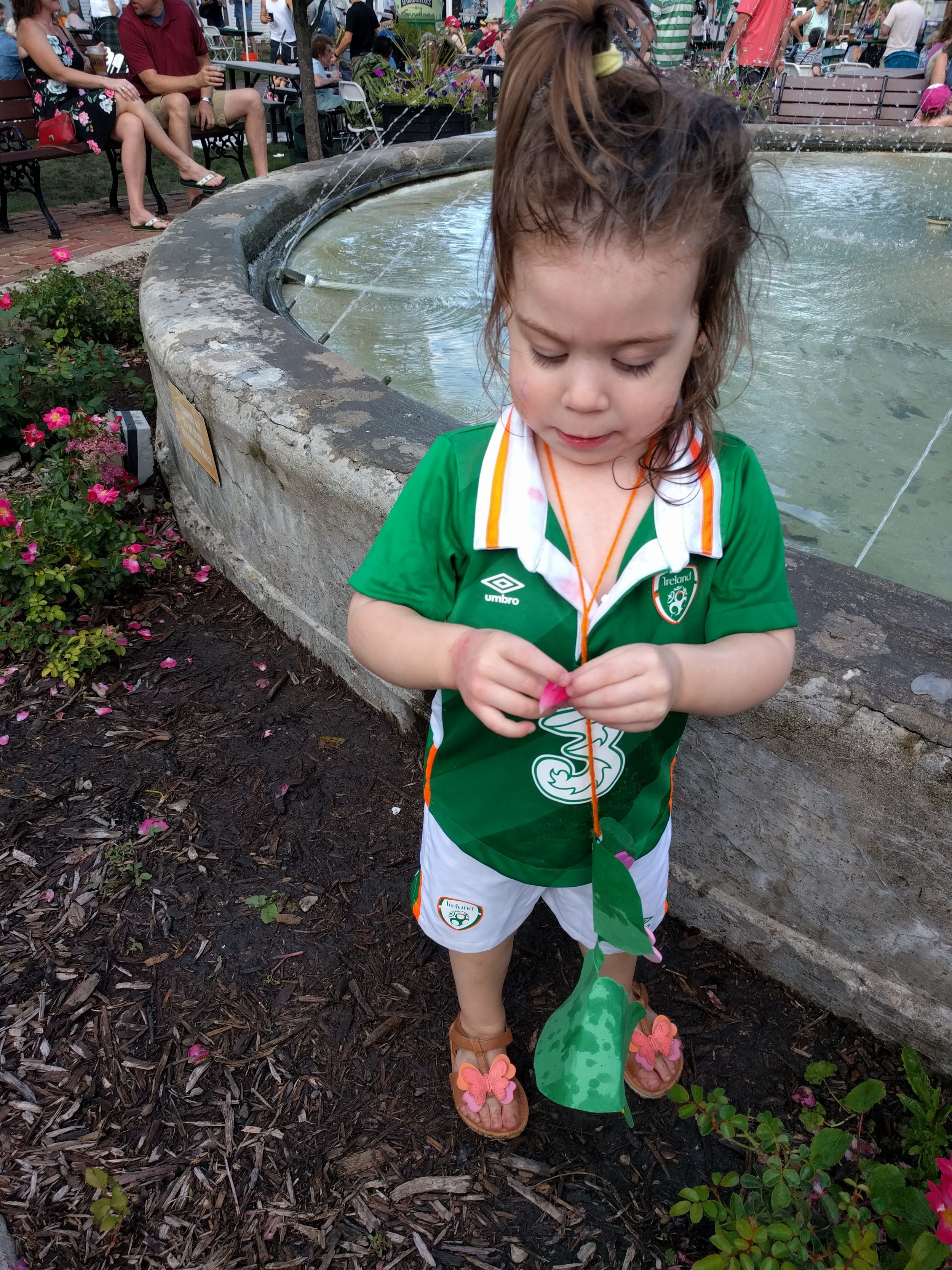 Evil Eve getting into the fountain and damaging the flowers (her necklace as well).