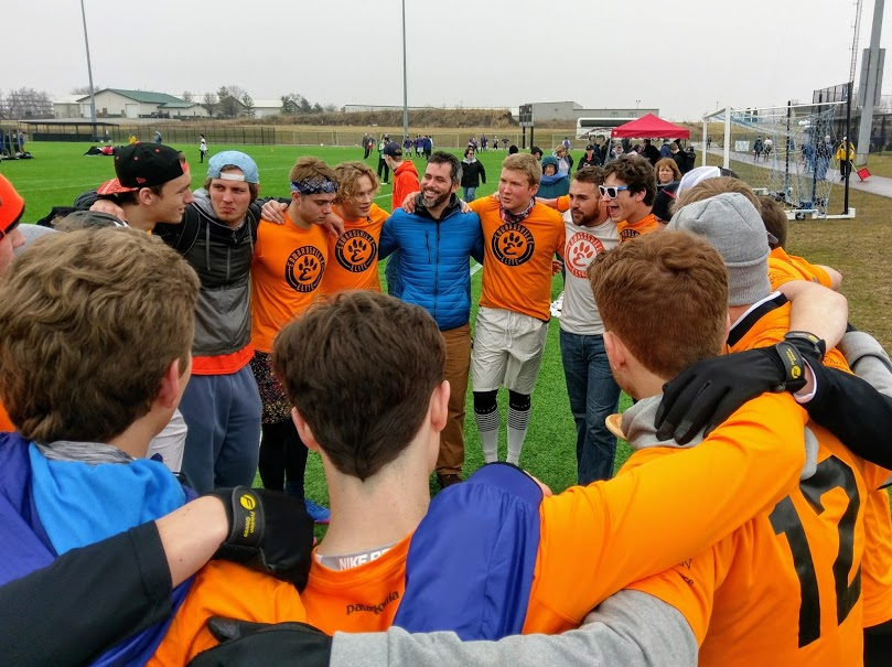 Andy Neilsen celebrates with the Edwardsville Elite HS Boys team after winning finals (initially seeded 10th of 10 teams).