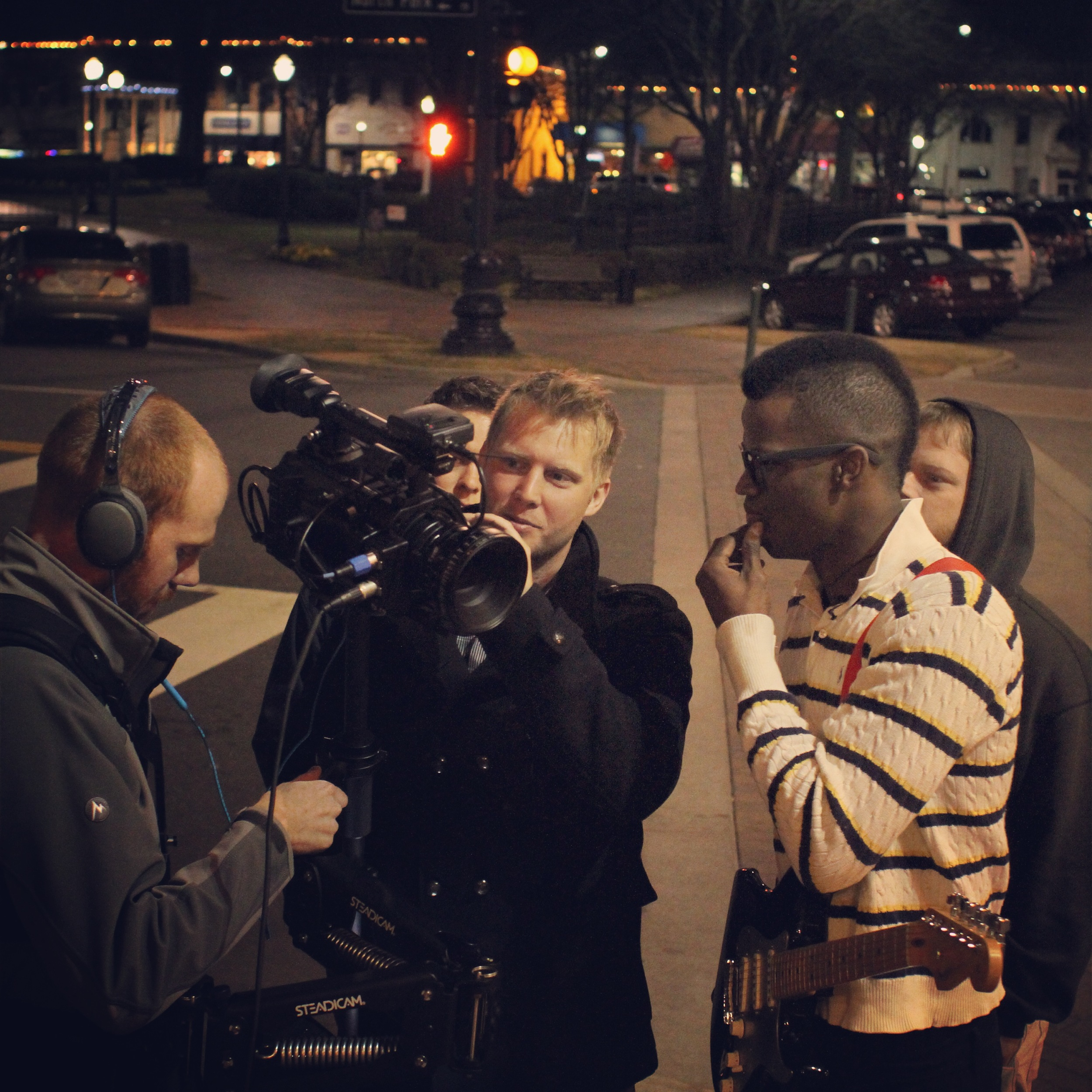 Jimi Cravity watching the last take.  Cold February night at the Marietta Square.