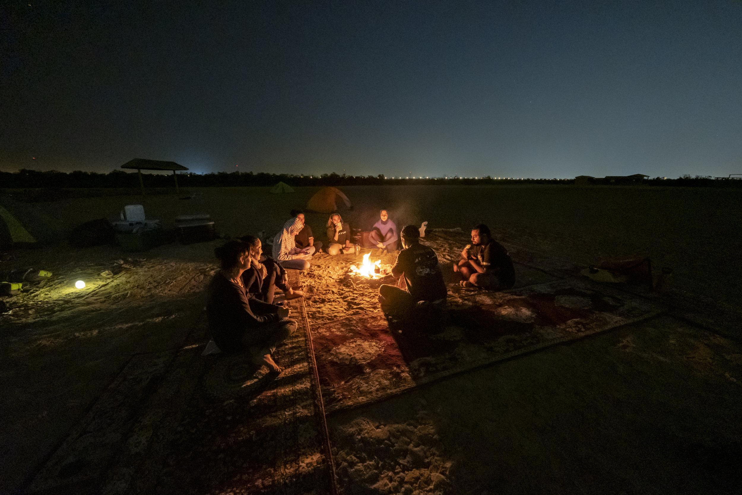 Sat around campfire on mangrove island_Abu Dhabi_(c)Oliver Wheeldon.jpg