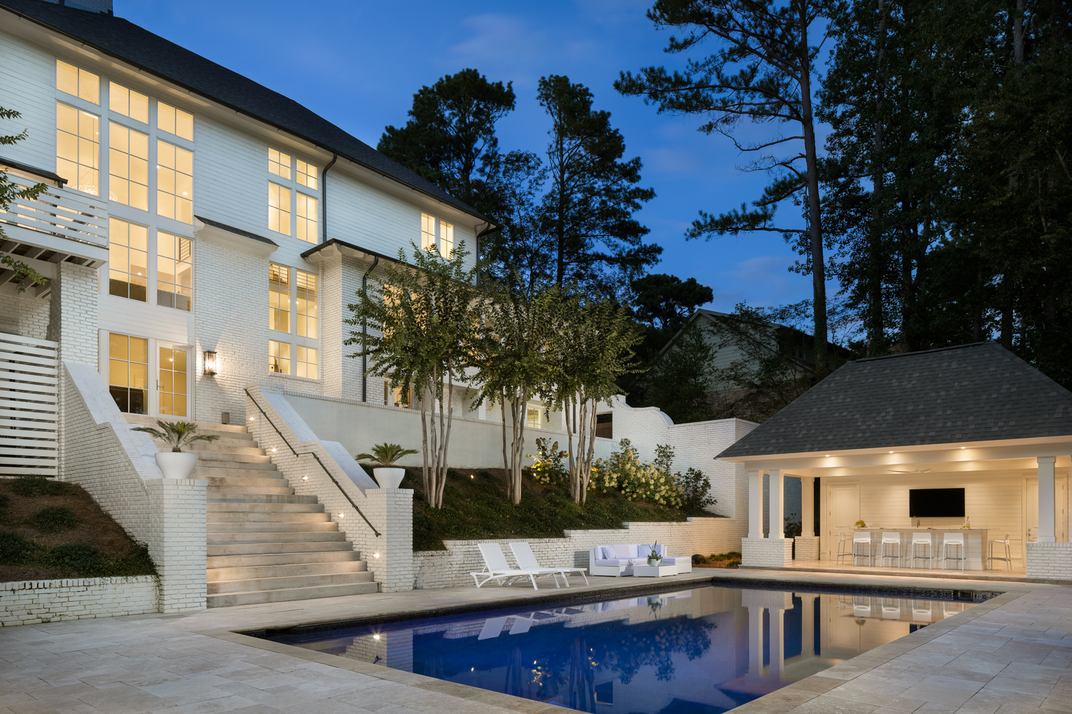 Twilight exterior of the rear and pool. This is one of the most extensive remodel projects I've ever seen. Hard to comprehend the before with the after!