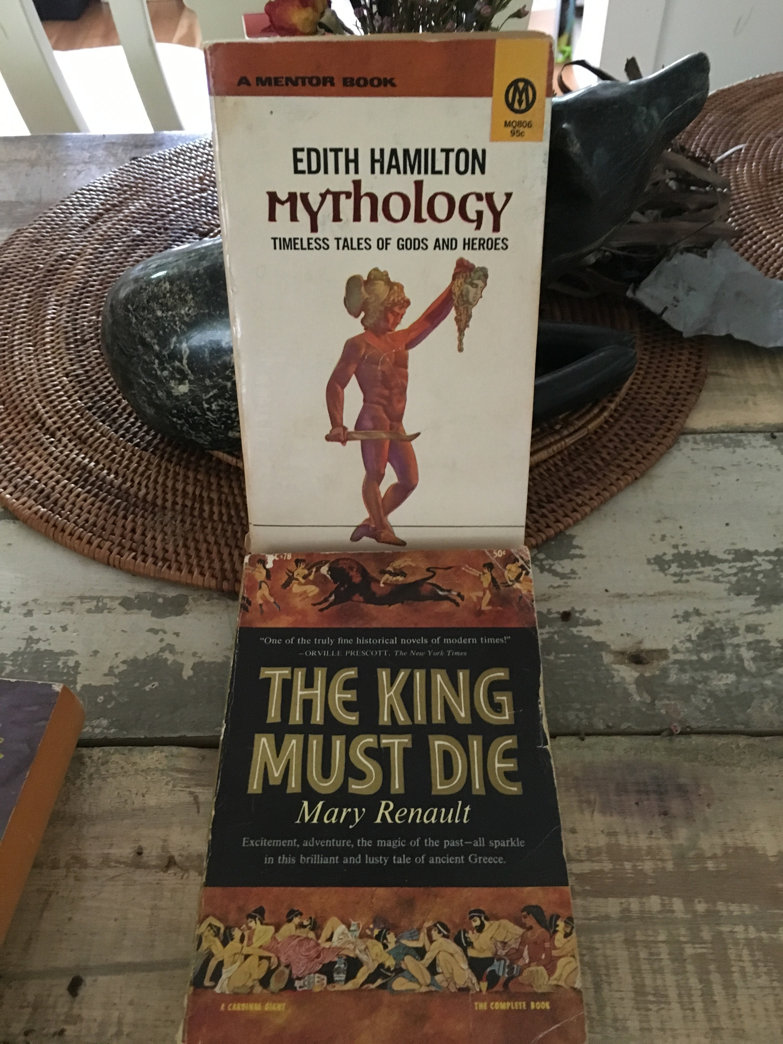 My bible: Edith Hamilton's  Mythology  I was thirteen when I discovered EH. (Note the careful placement of Perseus's sword. Hummm.)  The King Must Die —high school. Renault was transformative.