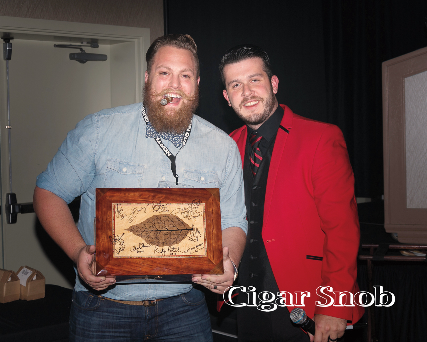 Blake Crossley hands over the signed humidor